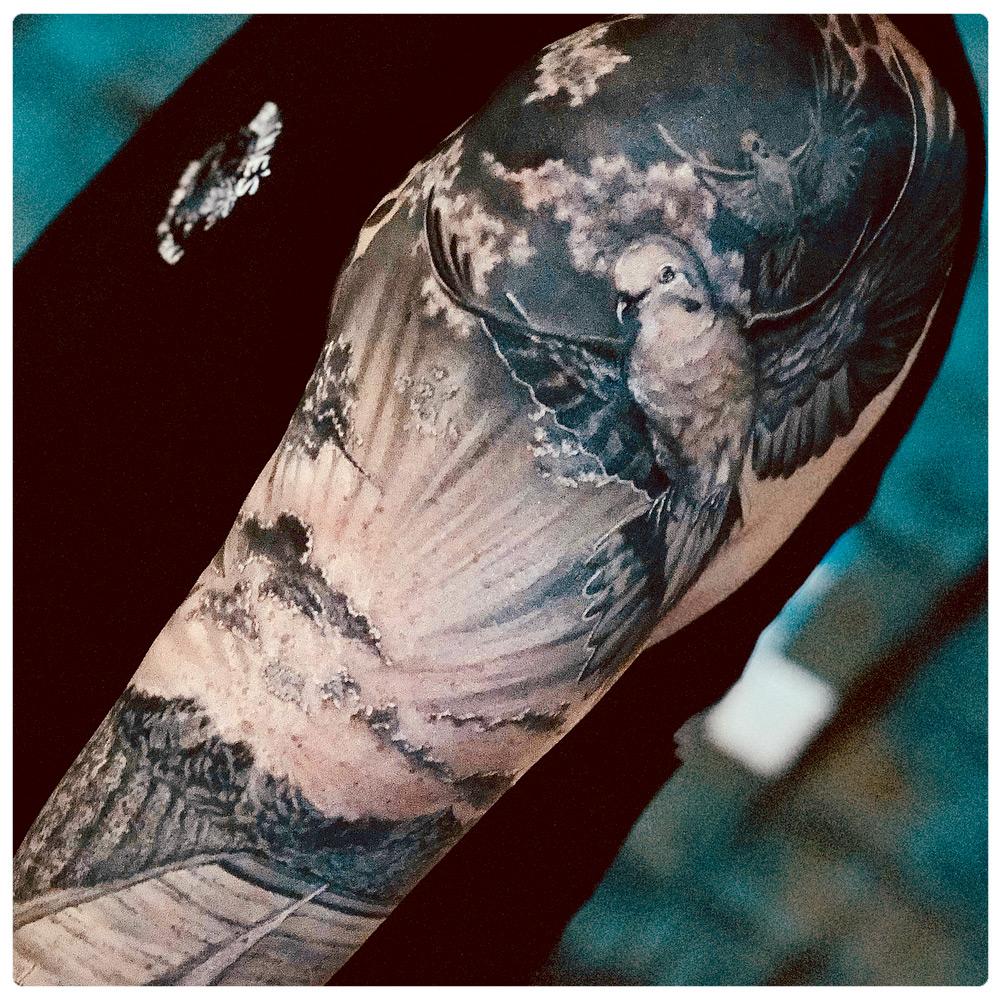 2018_tattoo_arm_birds-cloud-black-white.jpg