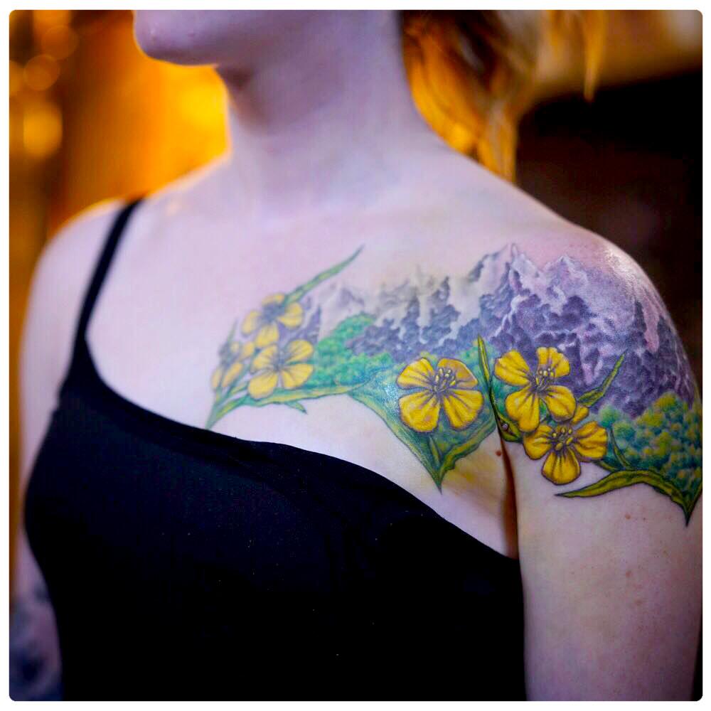 2018_tattoo_chest-arm_mountains-flowers-greenery.jpg