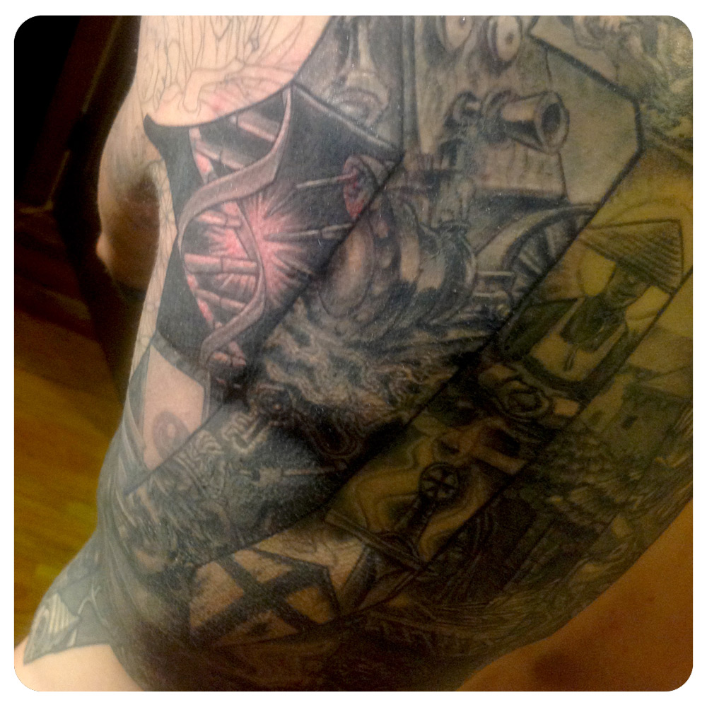 Back portion of the origin story wrap around timeline. | In-Progress Tattoo by Shane Acuff
