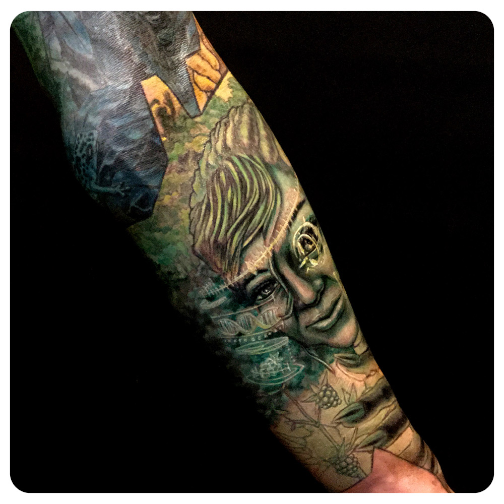 Lower arm portion of the Ishmael arm sleeve. The green represents our hope for the future with The Makers (i.e; the youth of today/tomorrow who will be able to use technology to find balance for The Earth) | In-Progress Tattoo by Shane Acuff