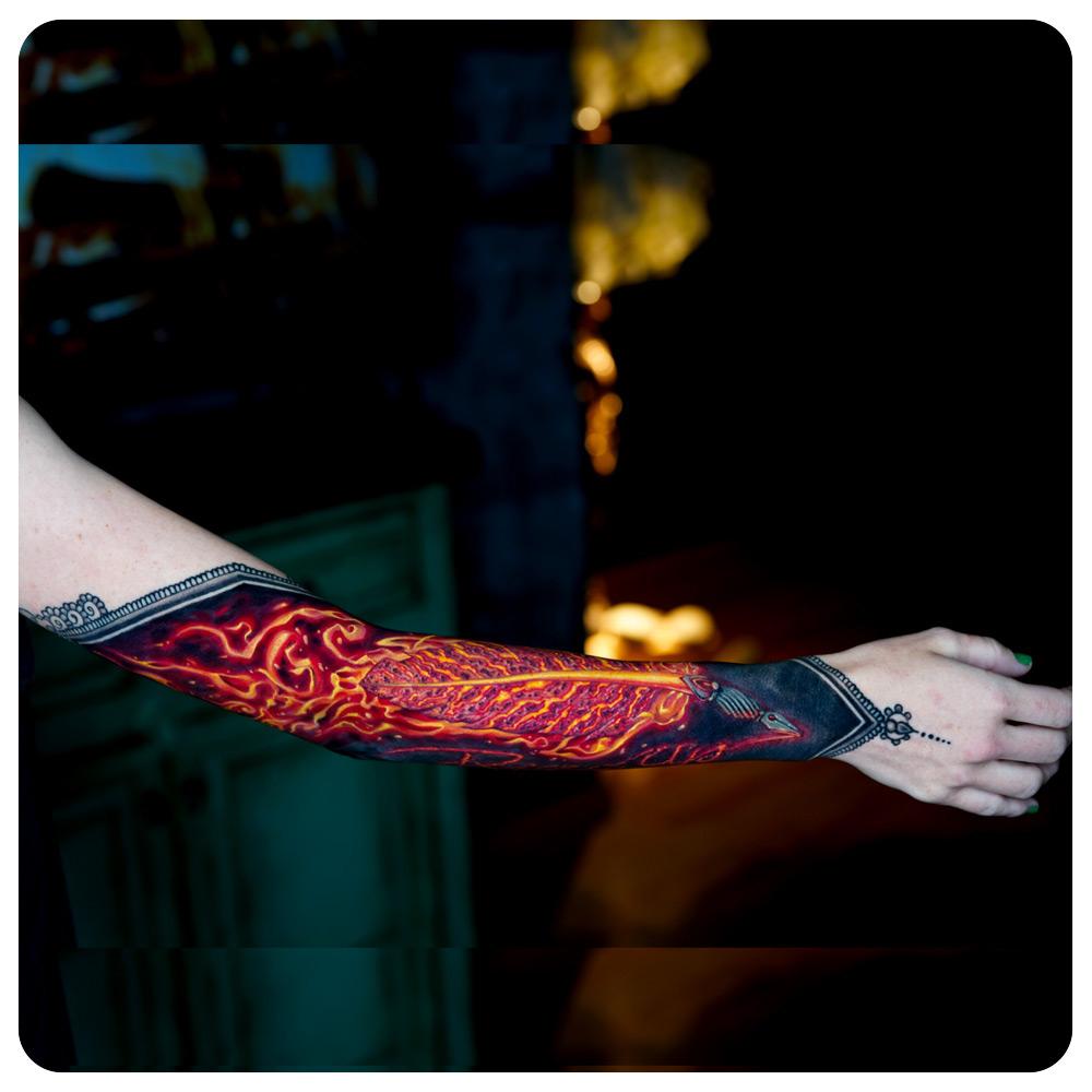 portfolio-1_2019_tattoo_forearm_illustrative_phoenix-feather-quill-script.jpg