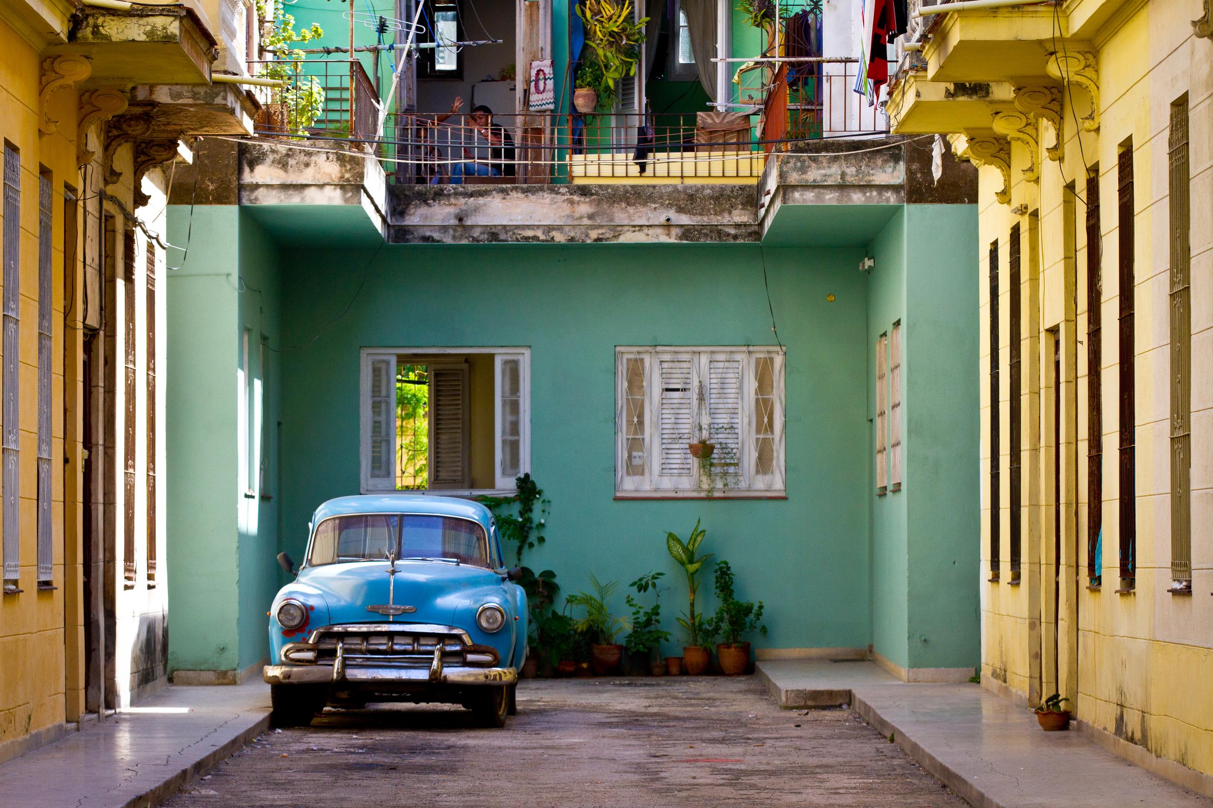 Beautiful vintage car in beautiful ally in Havana Cuba