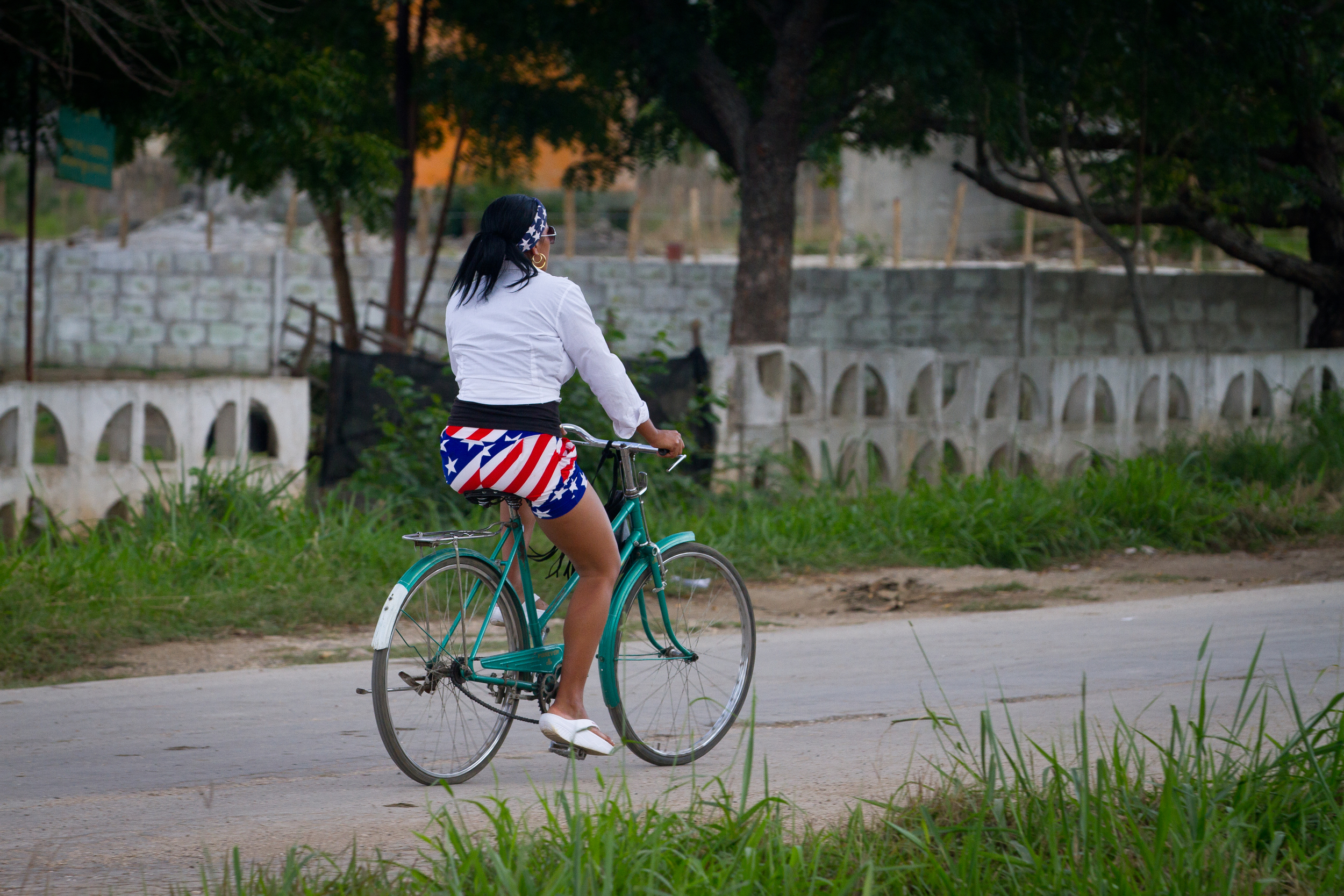 A young girl shows her enthusiasm for relations with the US, Ciego de Avilla, Cuba