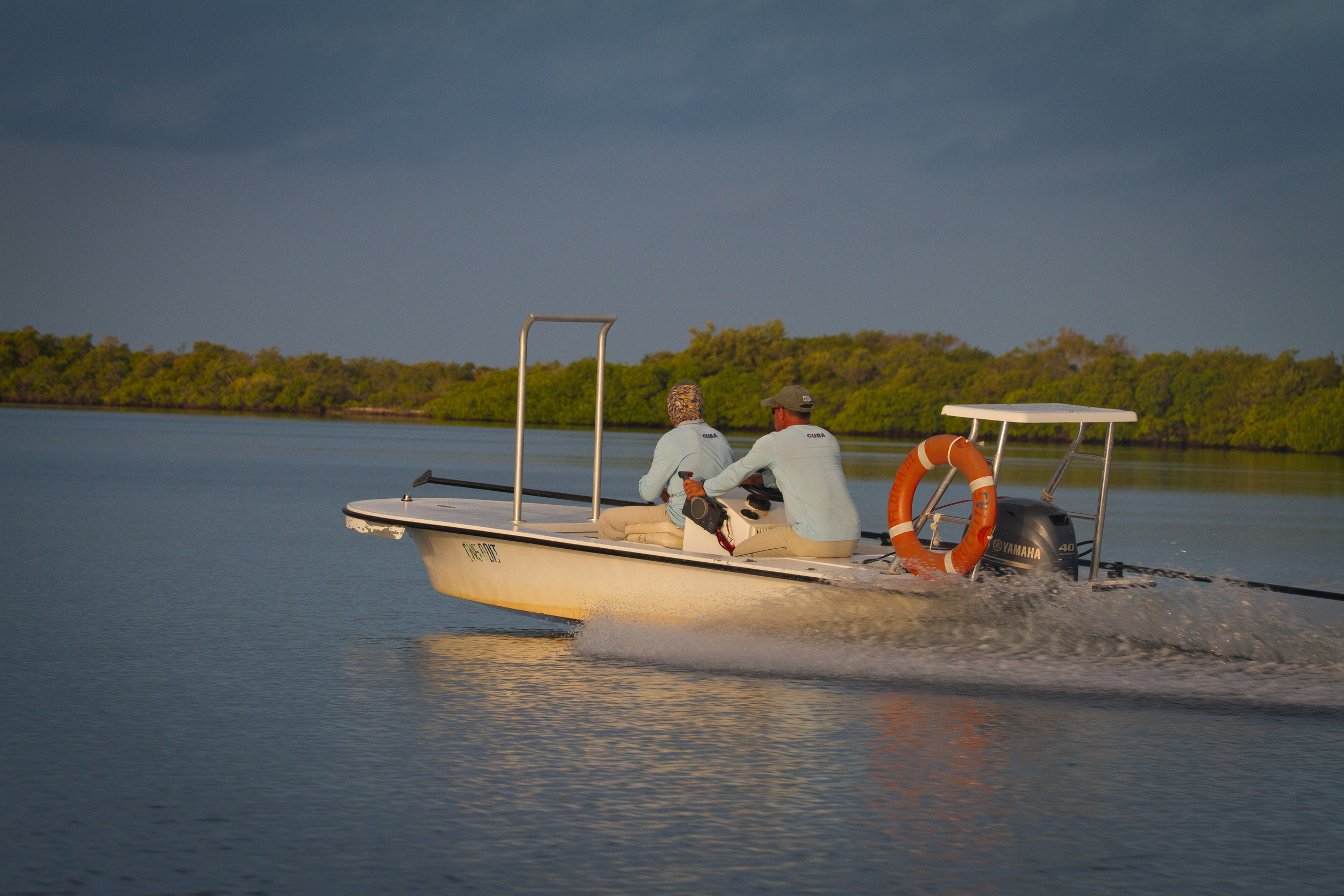Flats skiff departs the marina at Cayo Cruz, Cuba