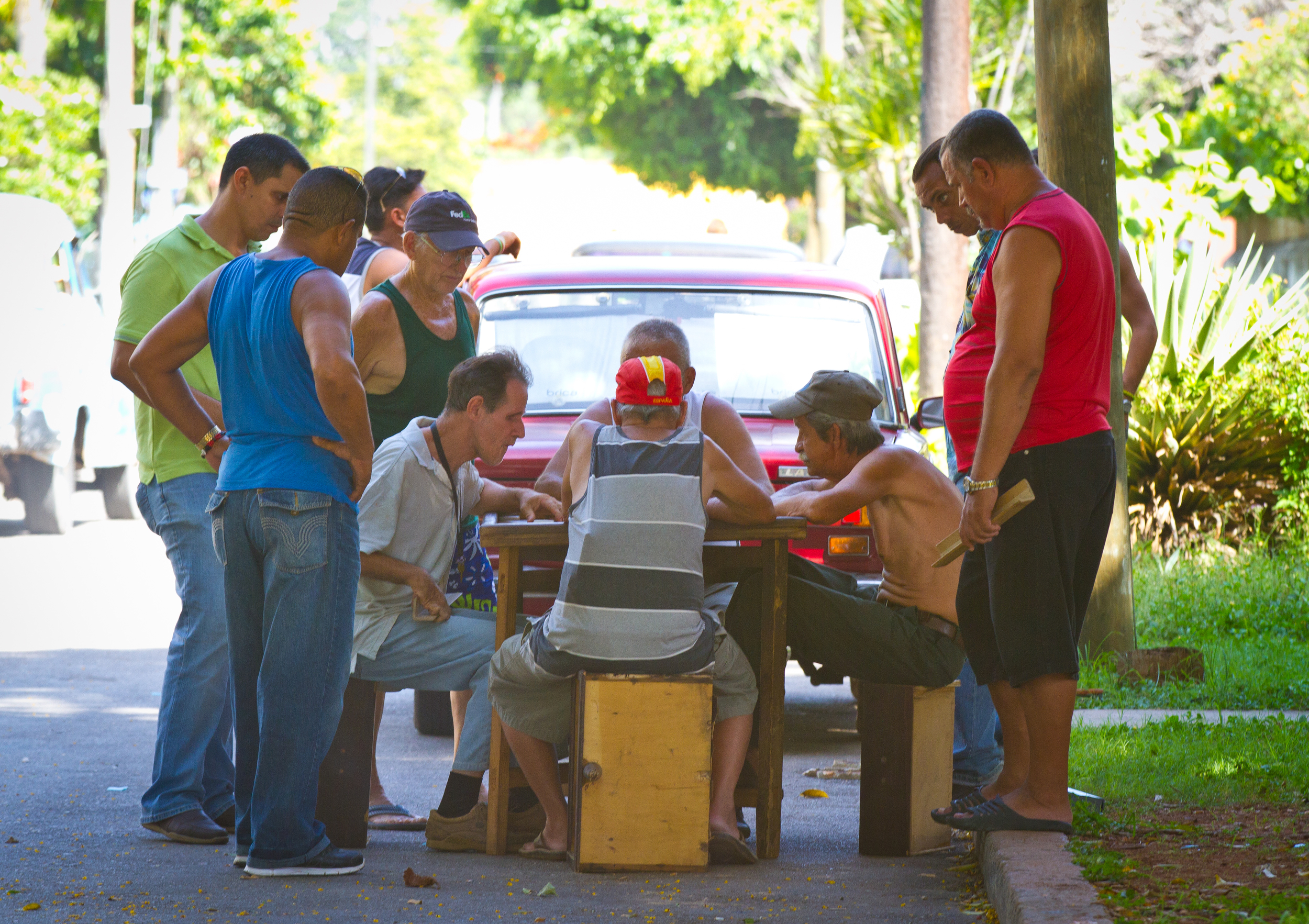 Local Cuban men gather to play tiles, Vedado neighborhood, Havana Cuba