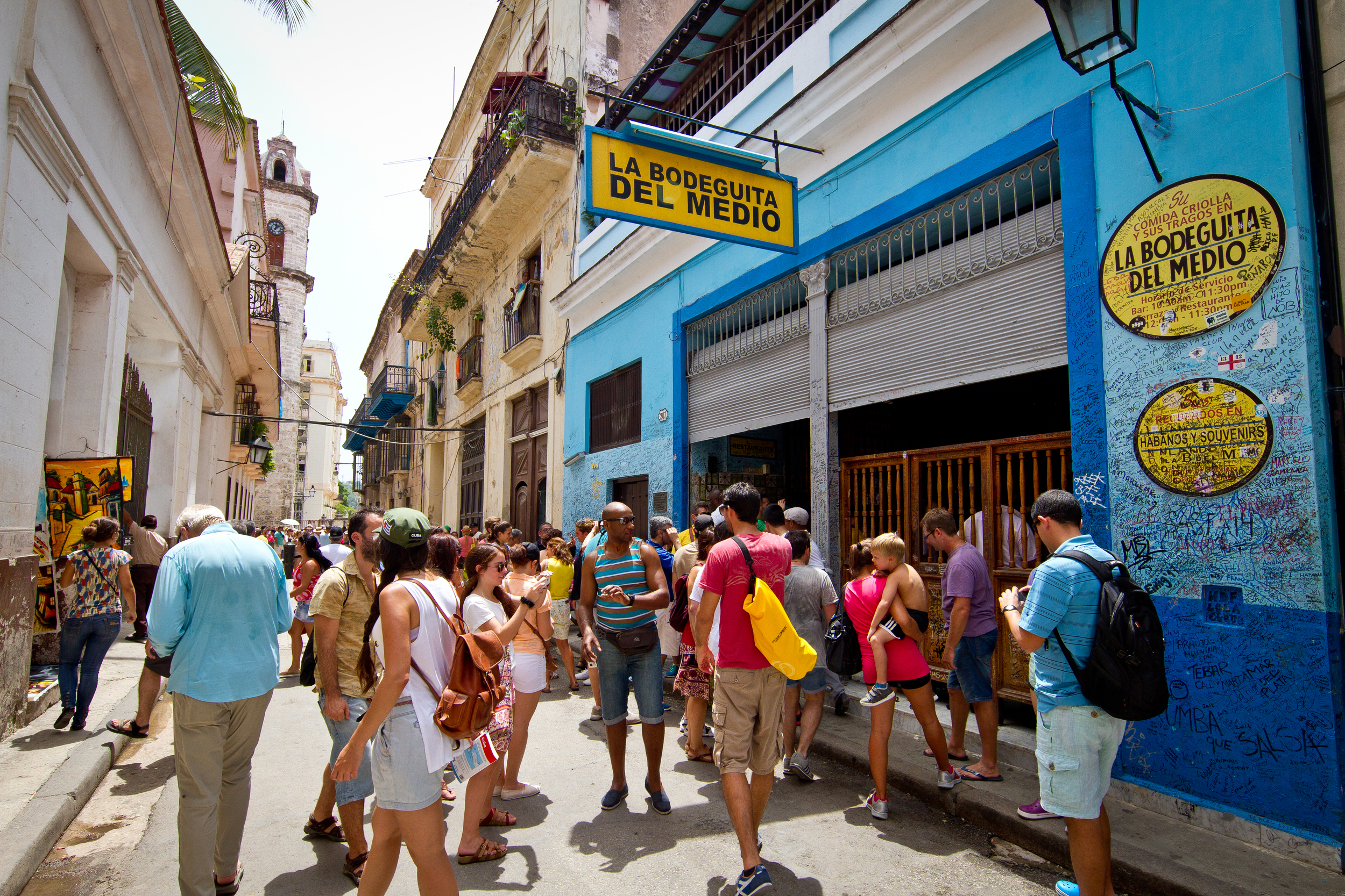 Tourists outside an old Hemingway haunt, Havana, Cuba