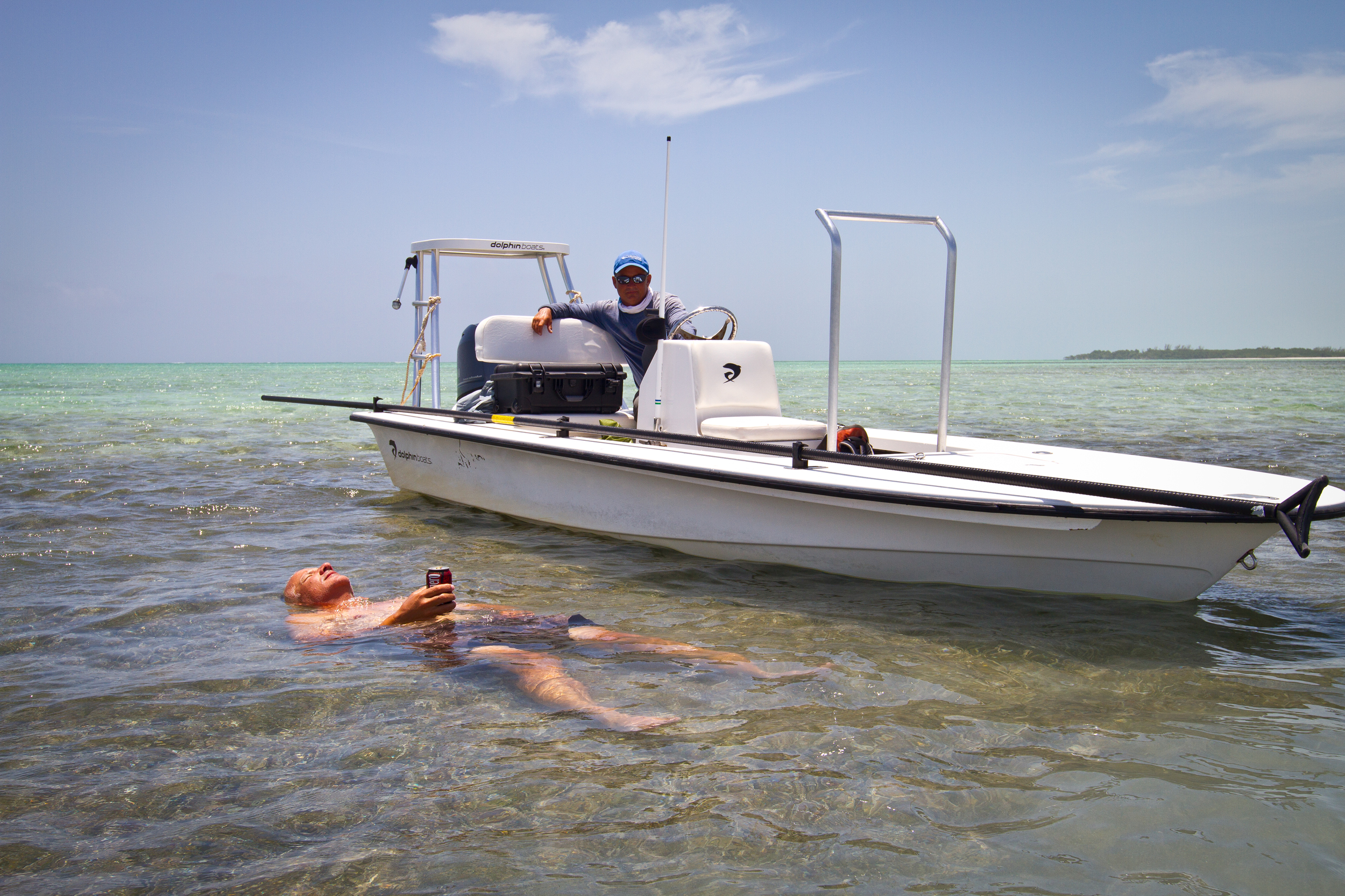 Jon Covich cooling off after wading a large Bonefish flat, Cayo Cruz, Cuba