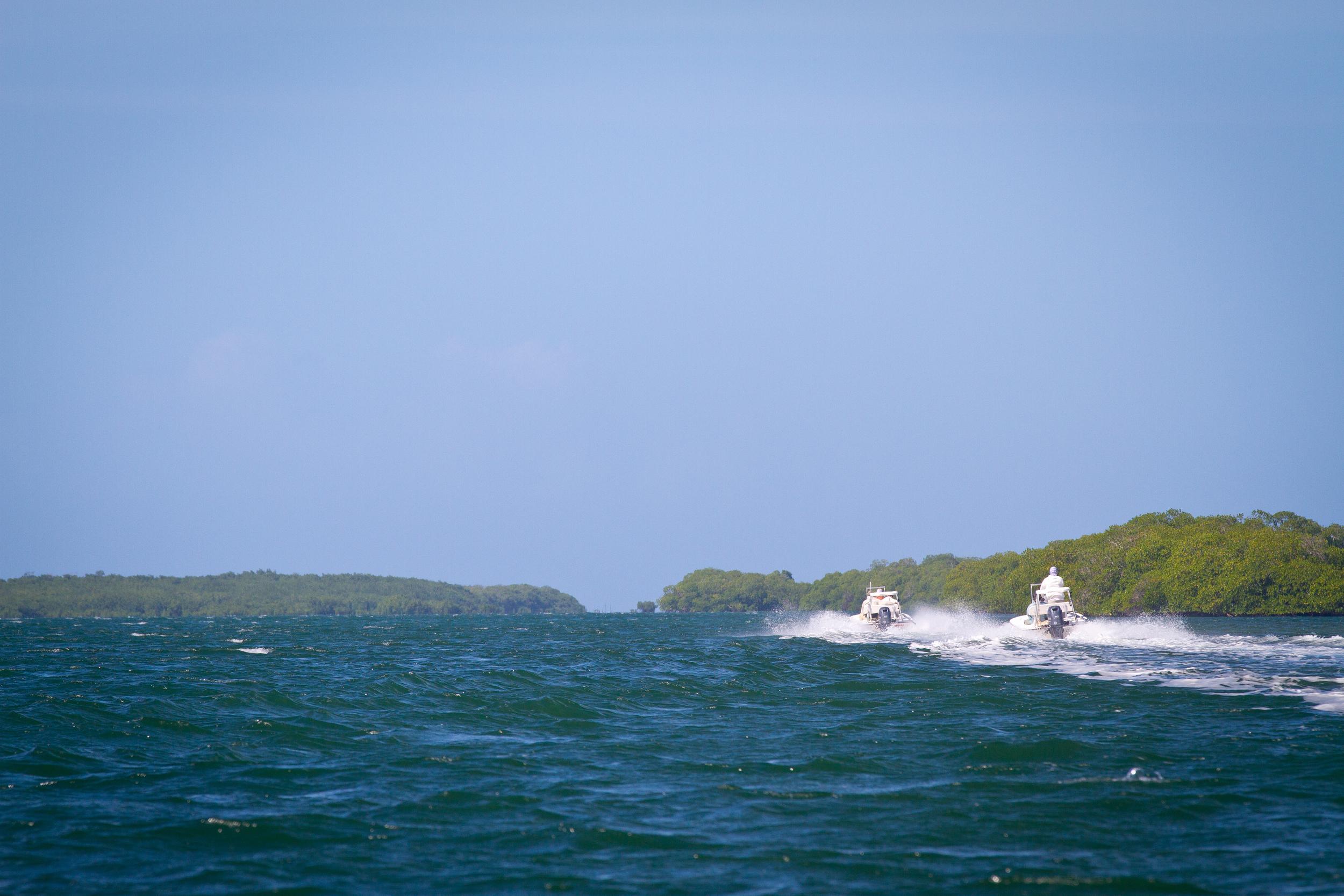Flats skiff running back to the mother ship, Cayo Cruz, Cuba
