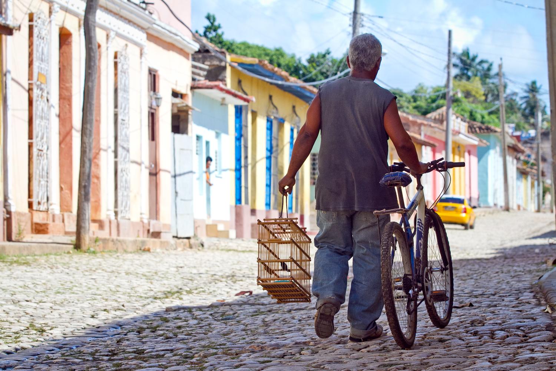 Man and birdcage, Trinidad, Cuba
