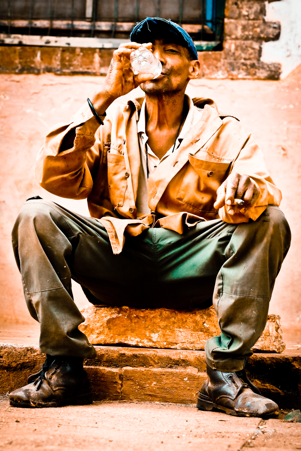 "Look at this guy, and you see Cuba. Just off his shift from the sugar cane processing mill, his clothes seem to reflect the colors of the revolution. With the cigar in his hand, and boots that have seen better days, he represents his ""Pueblo."""