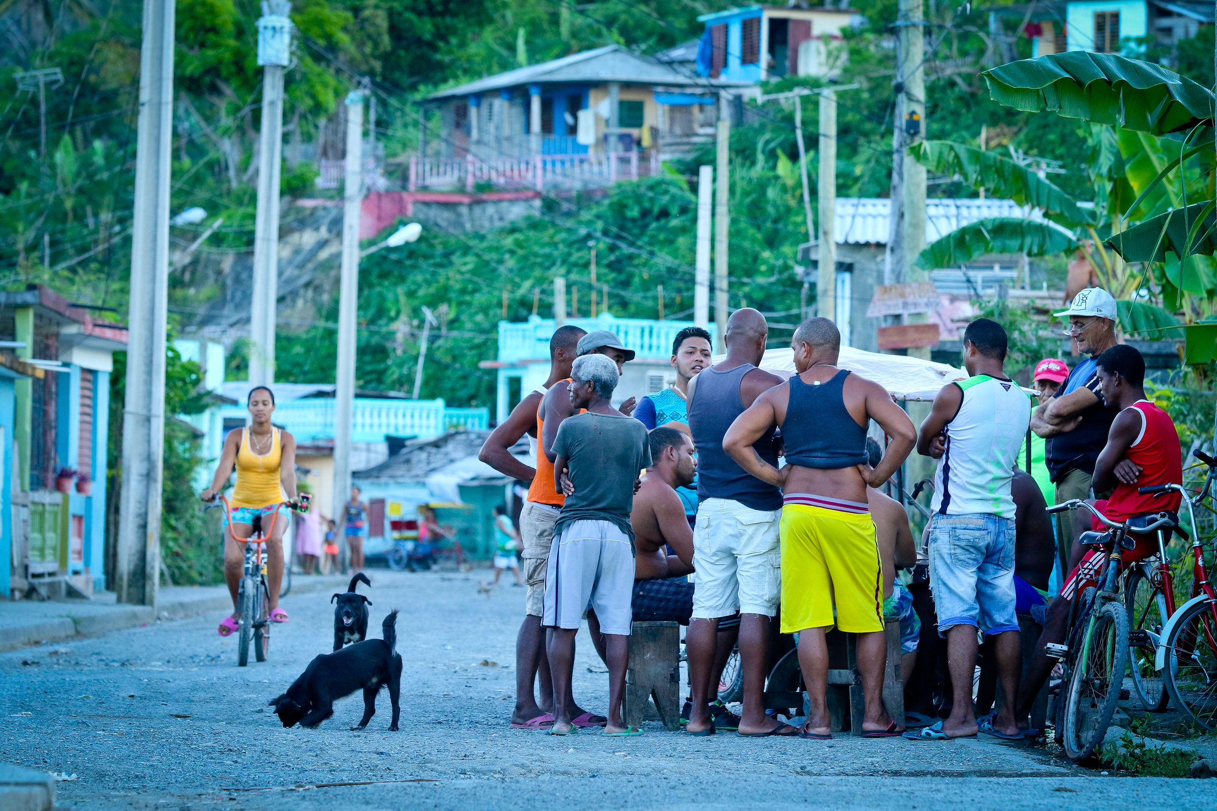 "Men playing ""tiles"" on a backstreet in Baracoa."