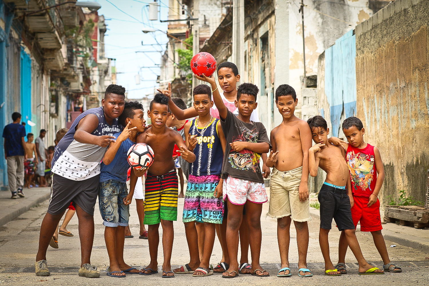 A great group of kids, they were playing marbles on this dirty side street when I came across them. Happy, grateful, and polite to be getting a few soccer balls from the USA.