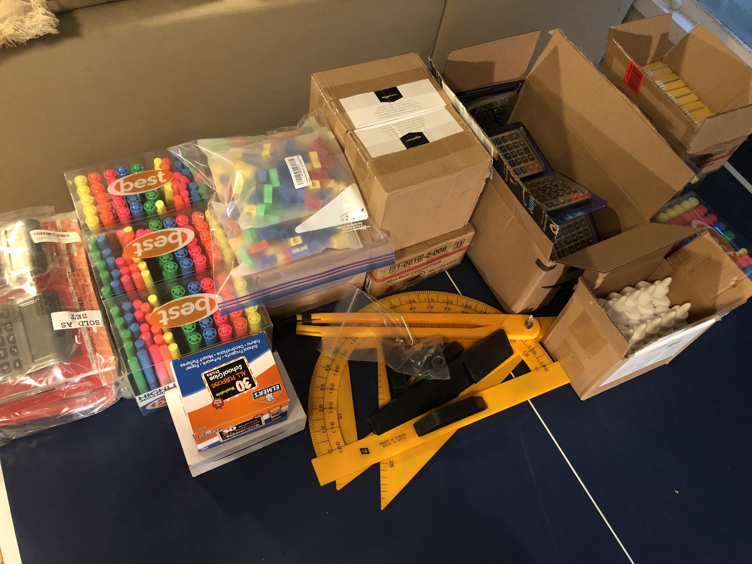 Calculators, hi-lighters, glue, pencil sharpeners, erasers, colored chalk and geometry tools