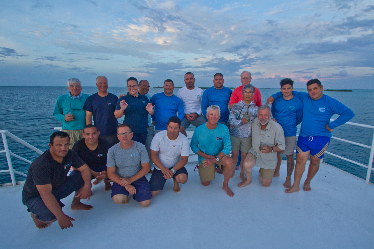 Boat staff, guides, and guests atop the Aggressor