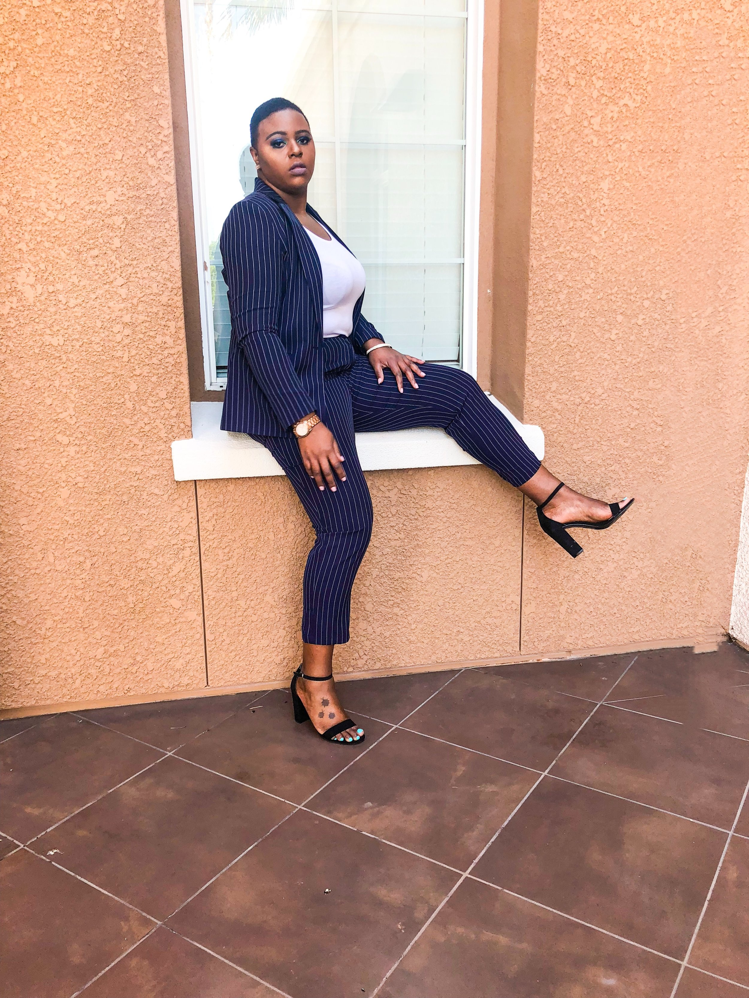 The fit of the suit is a large and it fits amazing. I really love the fact that the suit is blue pinstripes. I decided to pair it with a white tank top. This is great for an event or even brunch .A must have to keep in the closet .