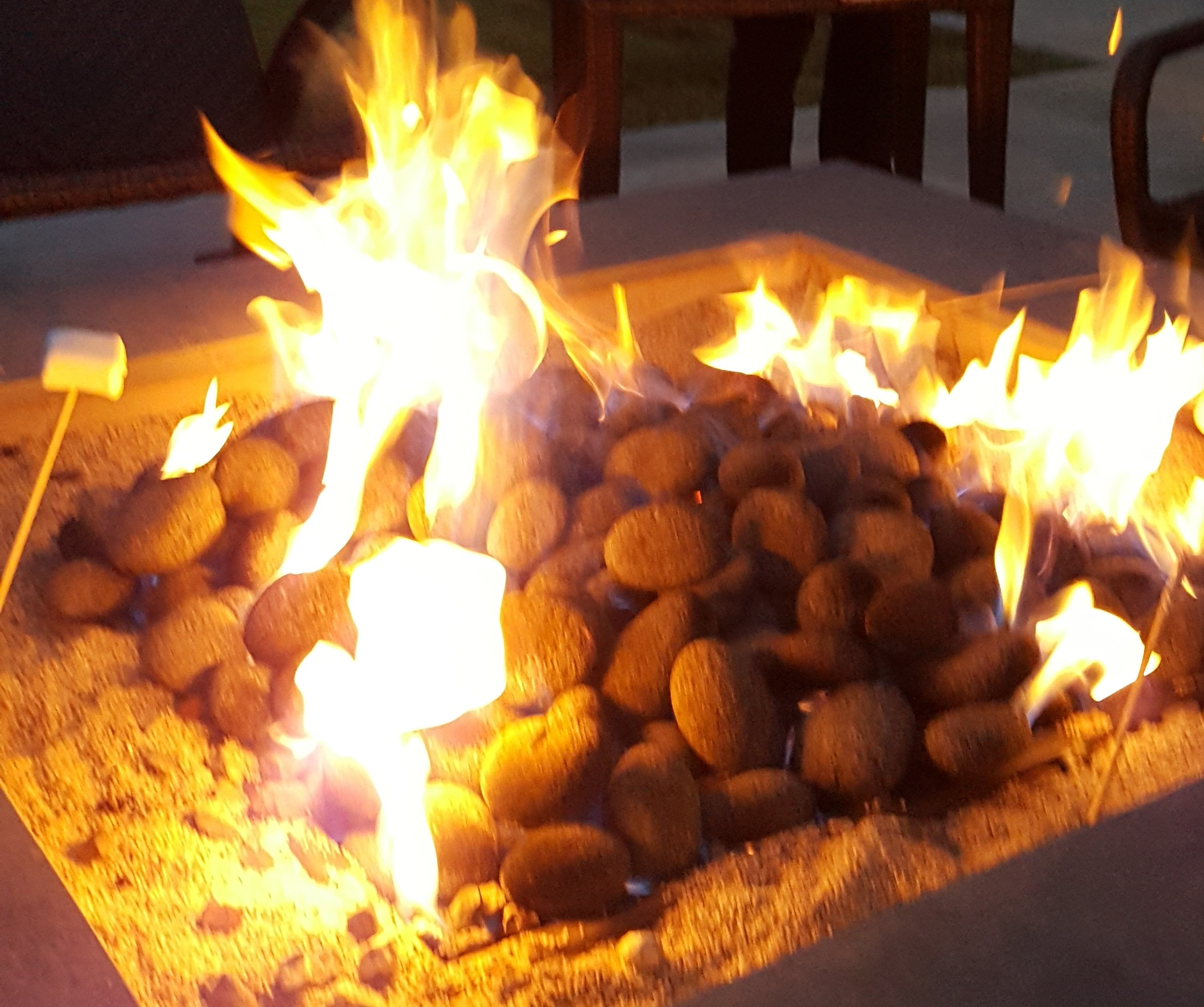Carefully planned work schedules leave time for family gatherings like s'mores around the firepit.
