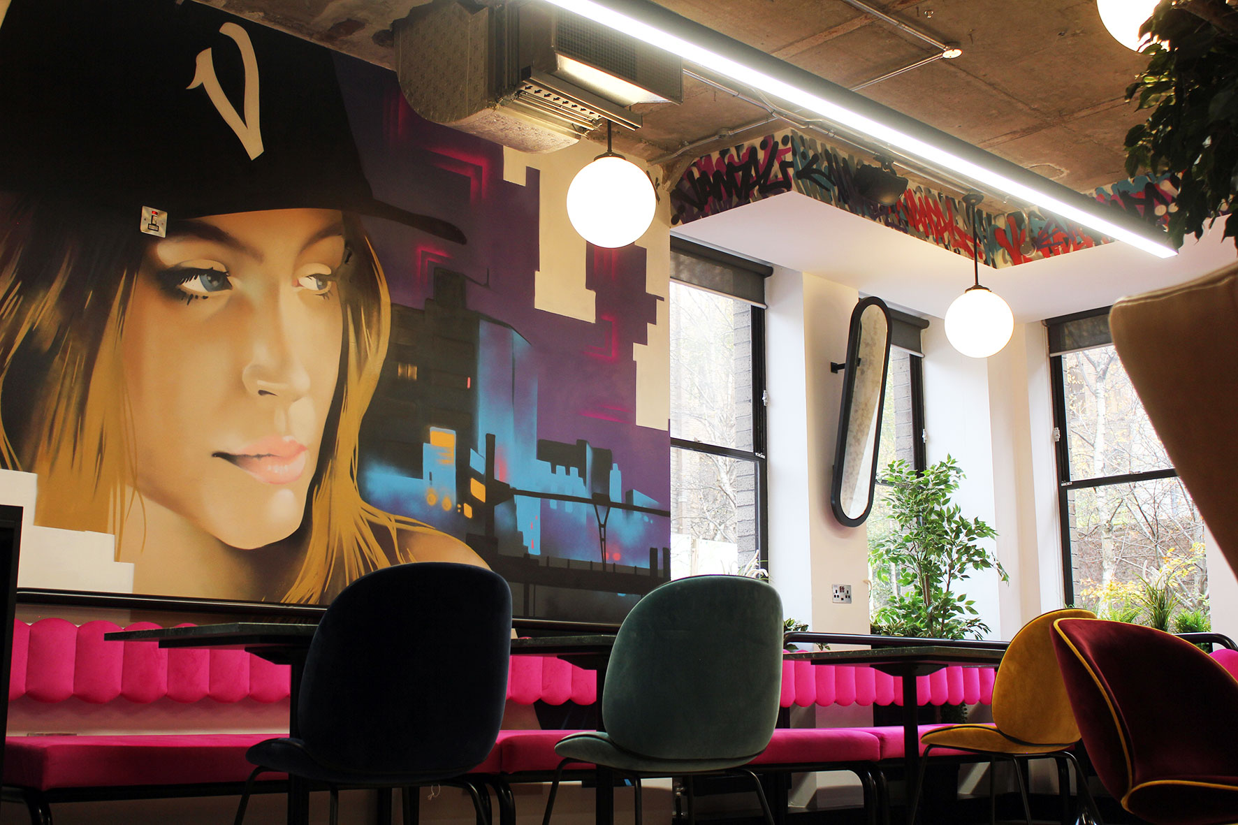Iconic Offices' location at The Greenway utilizes original art, bright colors and expressive design through its workspace and common areas.