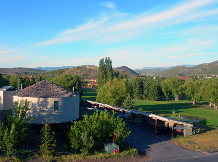 Sunset over water tower and golf course / Park City, UT