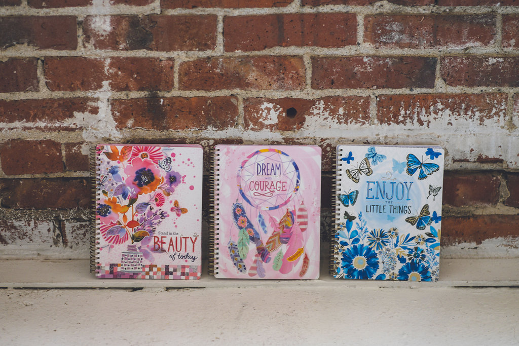 My FAVORITE product is the Medium Spiral Notebook! Three different designs to choose from. Each has printed pages inside with 4 different designed page spreads.