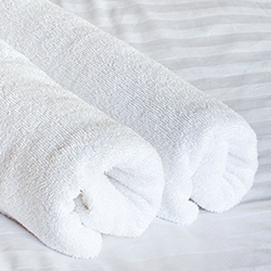 Premium Collection  - Spun, optically bright and poly blended for strength. We combined the best of both our hospitality towels and institutional packing to offer a soft towel that is bale packed for freight efficiency and space savings.