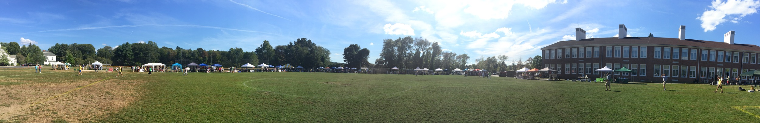 Panoramic view of the Fair, held on the athletic fields of the Town Building.