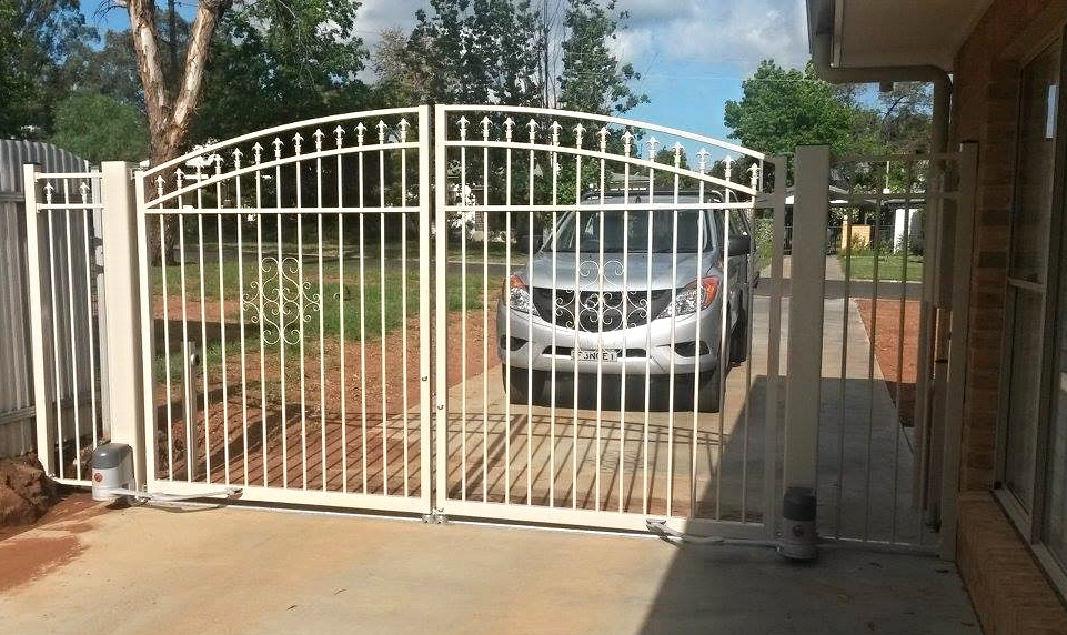 Curved Spear under Bar Double Gate with figure eight scrolls in Terrace. With auto openers.jpg