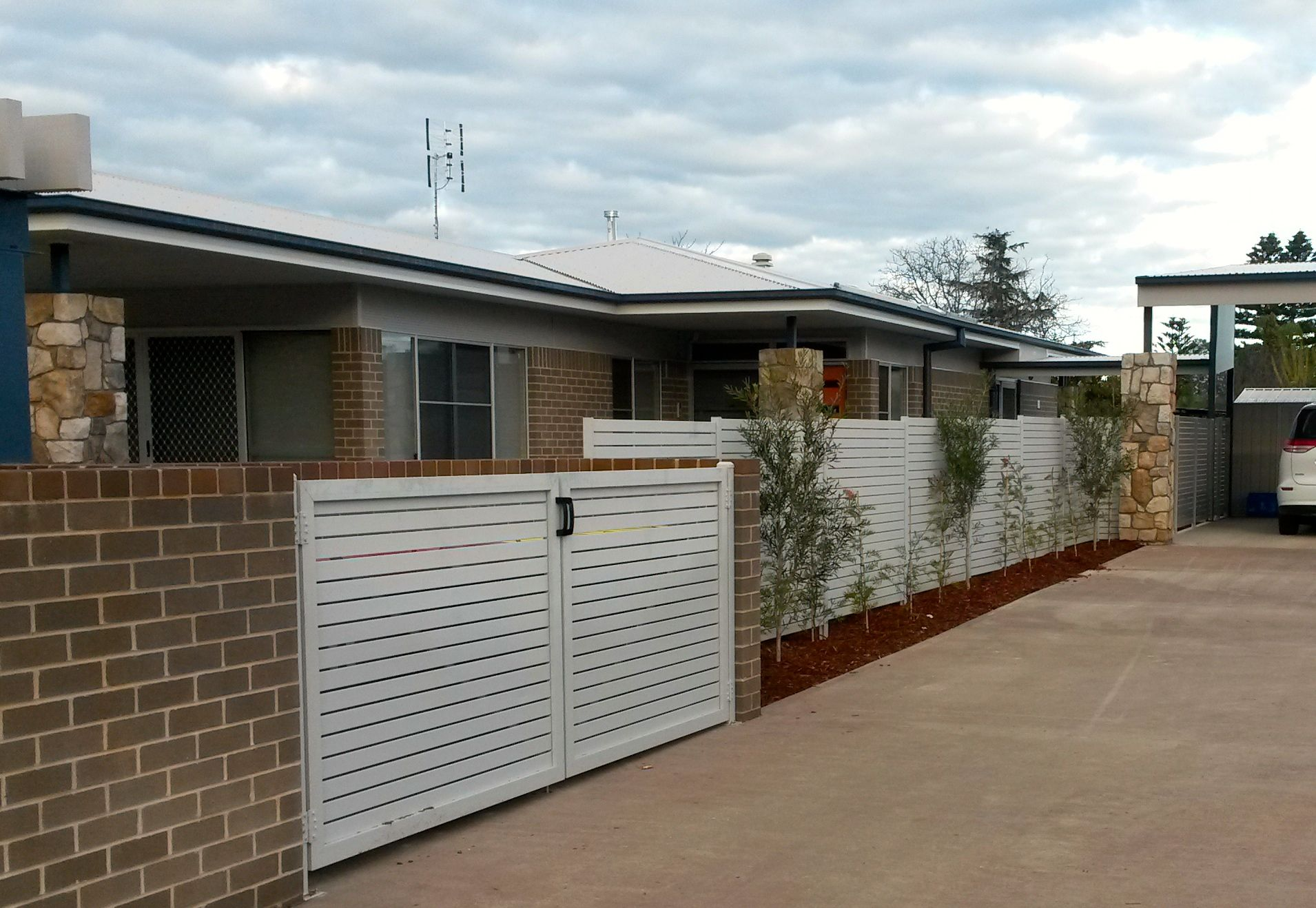 Horizontal Picket Fencing and Gates used for waster enclosure.jpg