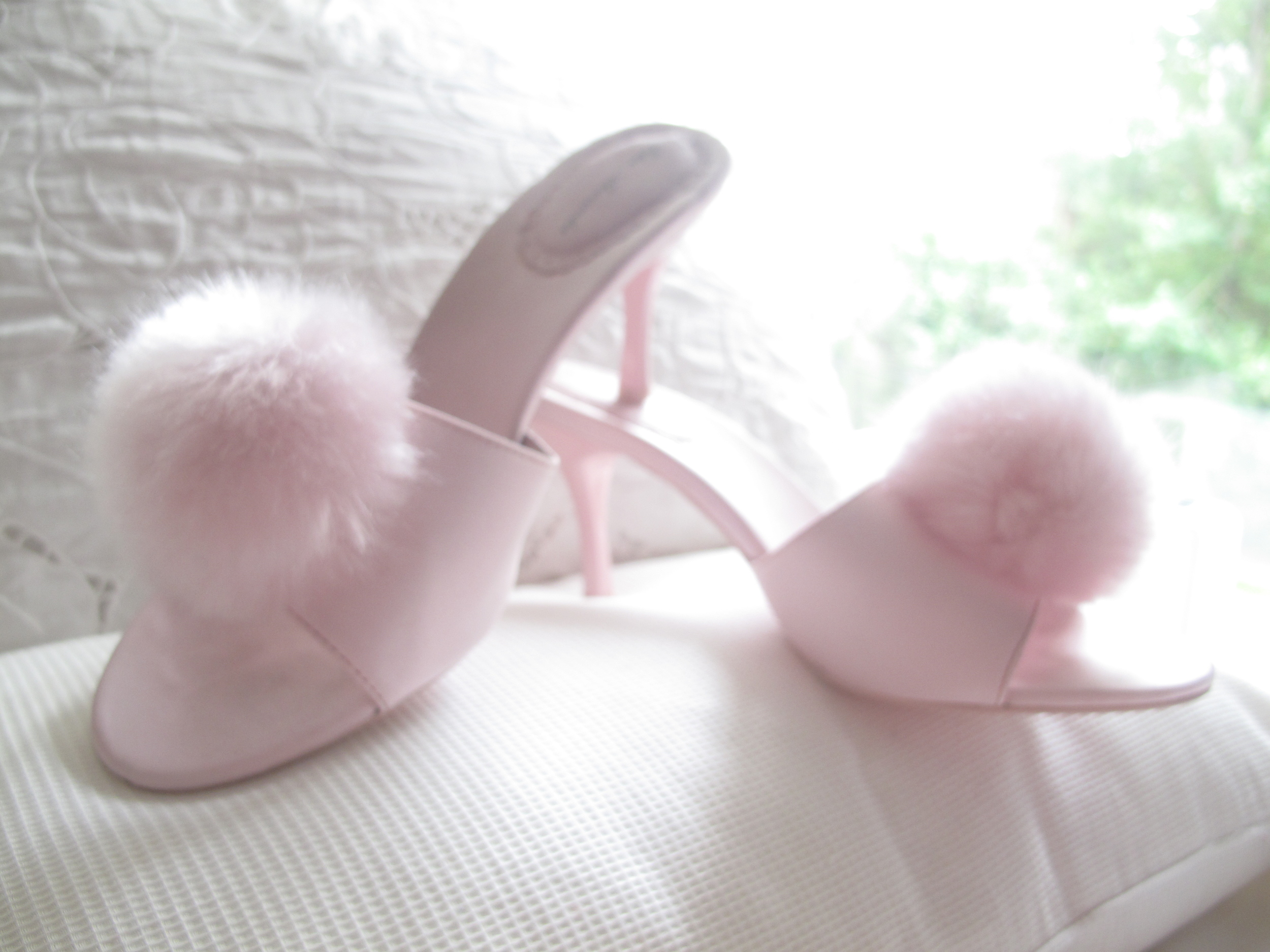 Pink marabou slippers in soft lighting