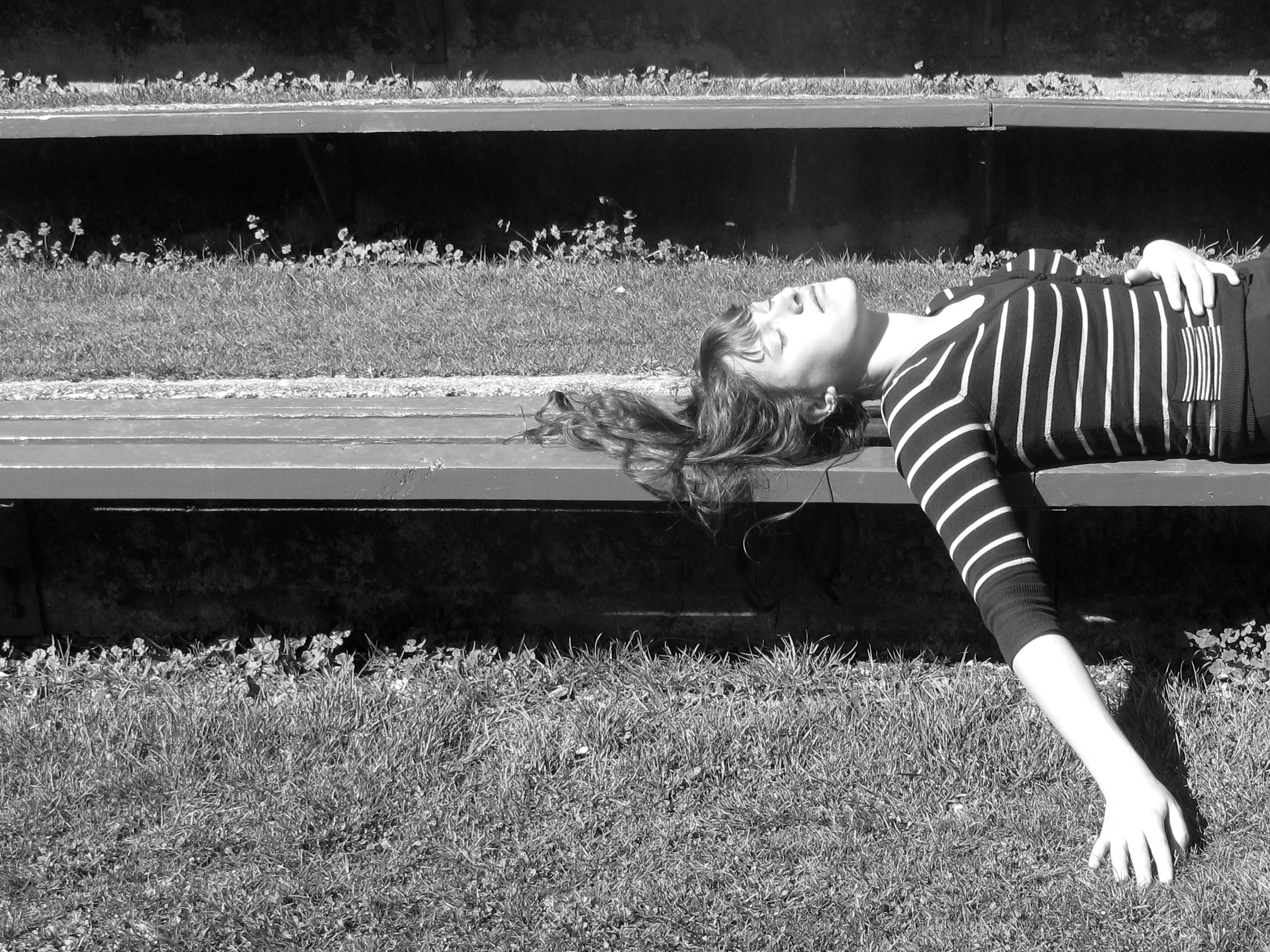 Lying on the benches in the sun