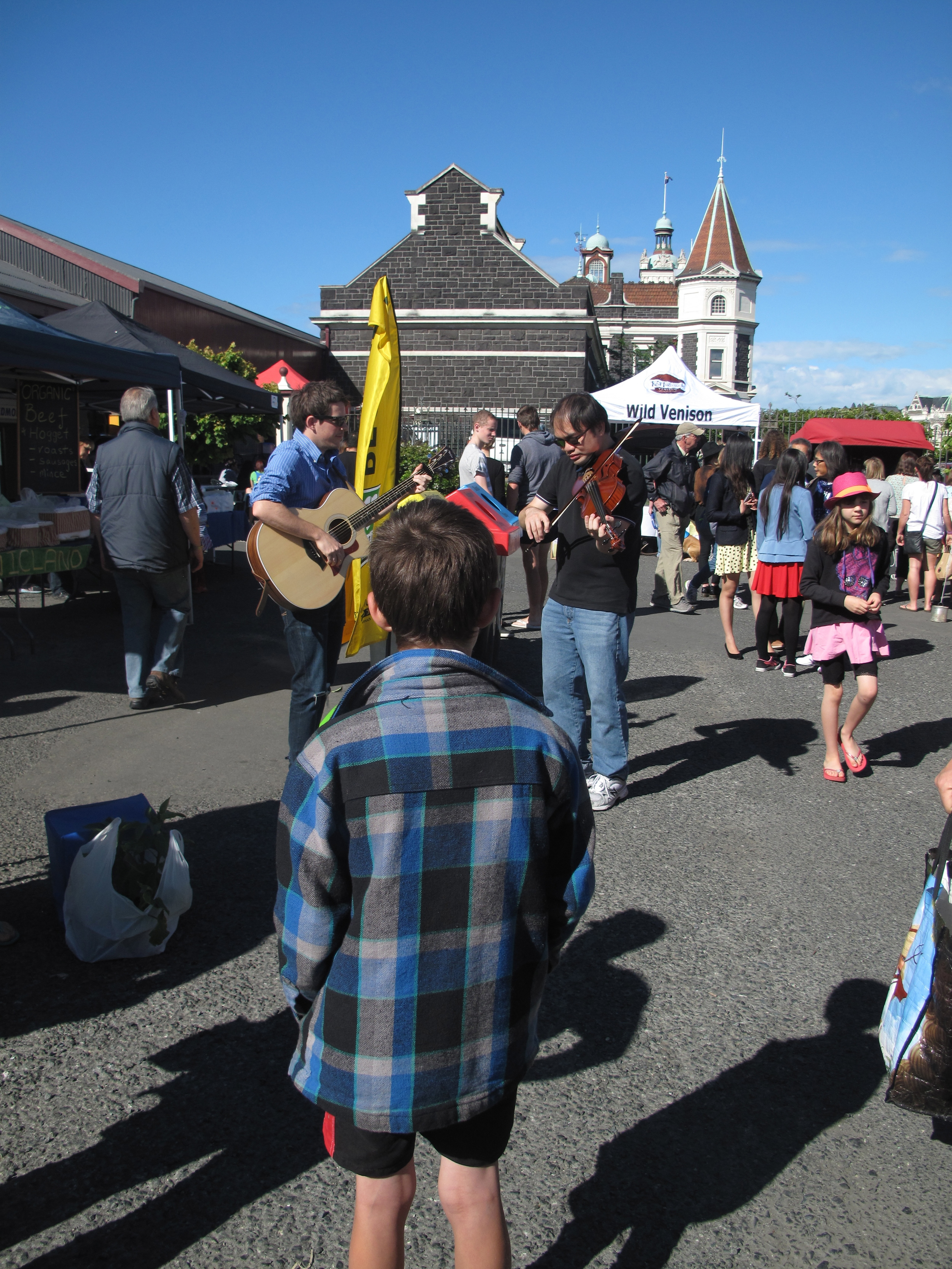 Boy watching buskers at the Otago Farmer's Market