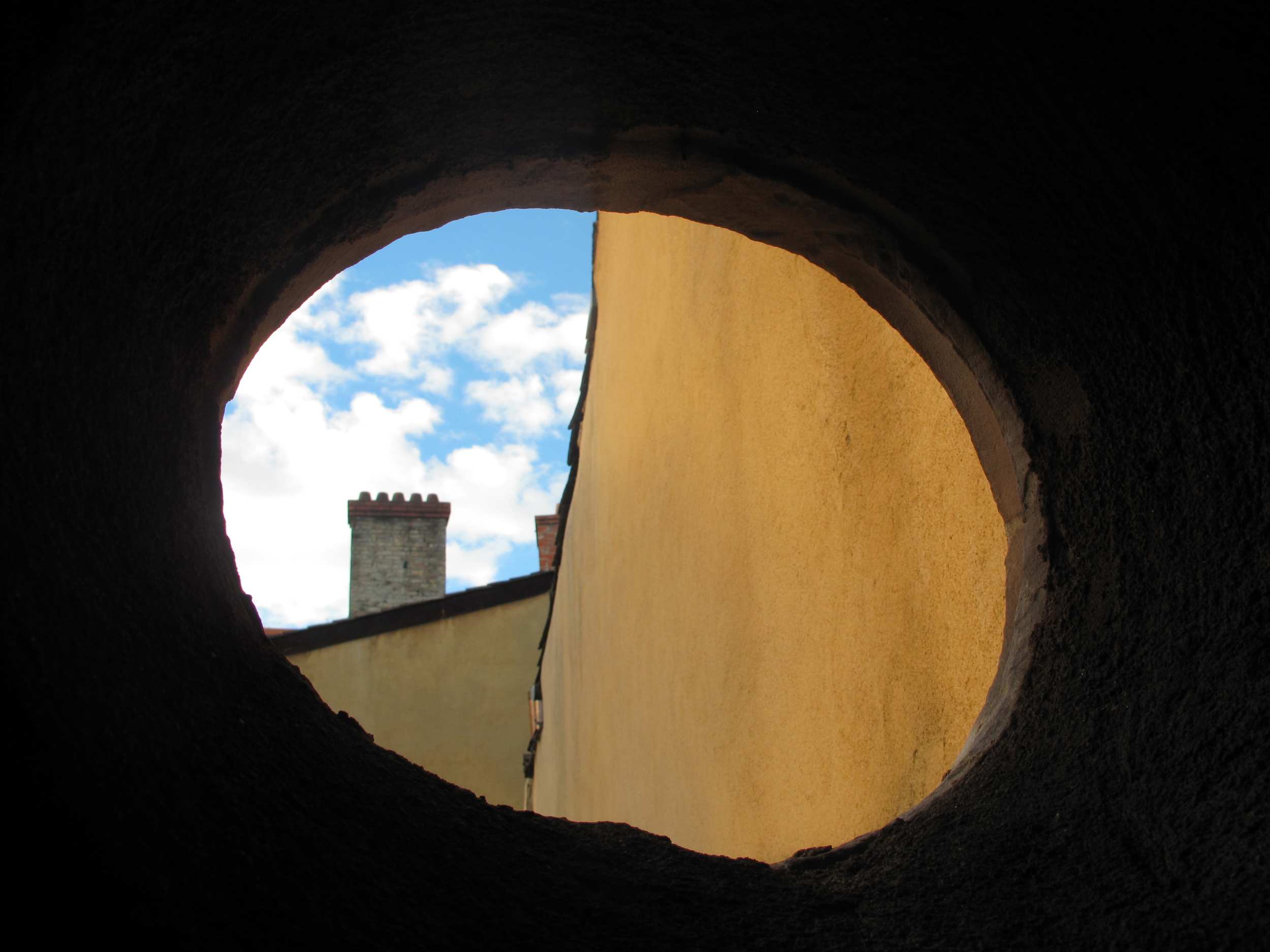 Traboules window onto Lyon, with a view of a chimney