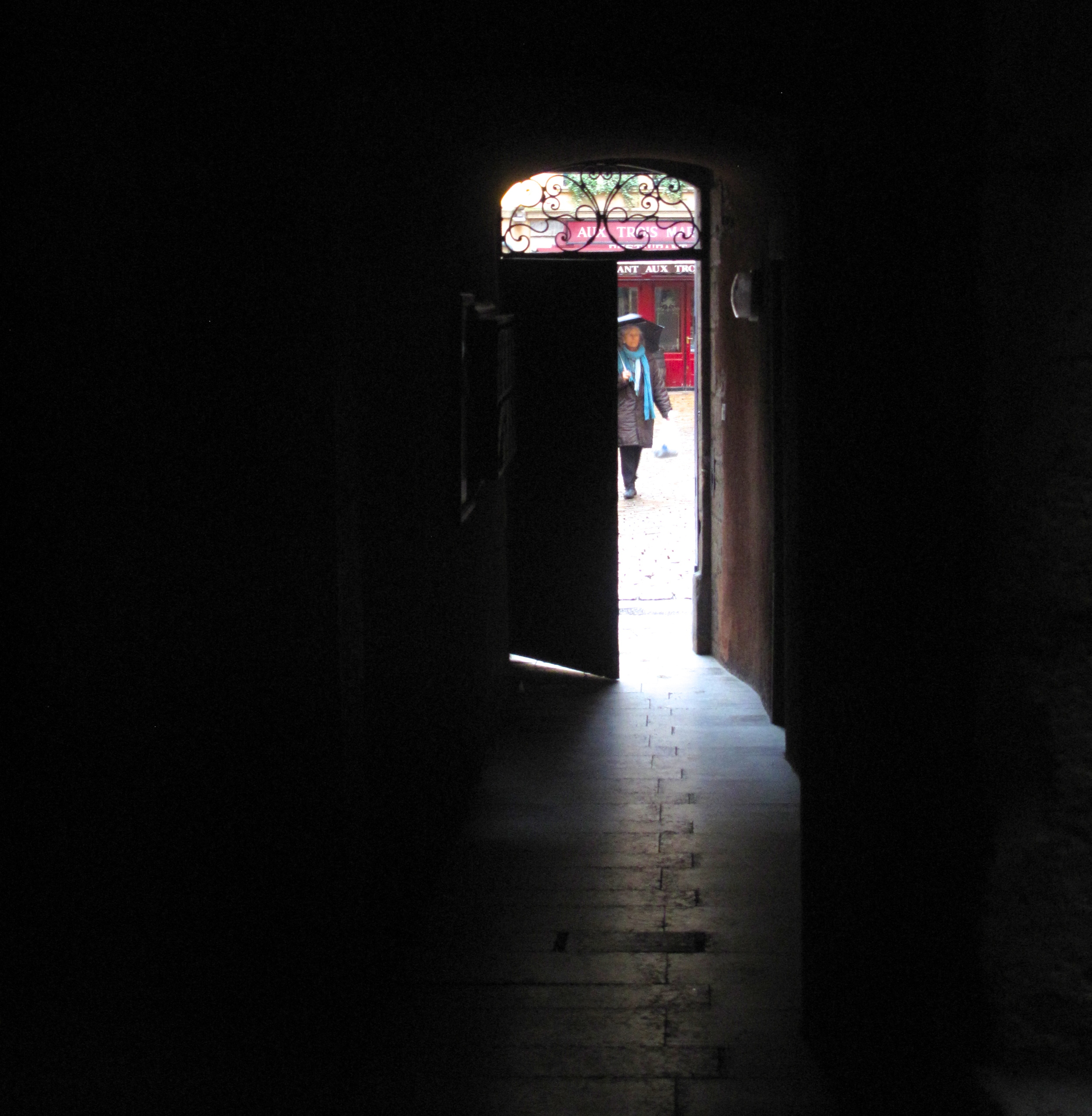 A door and a dark passage to the hidden Traboules of Lyon