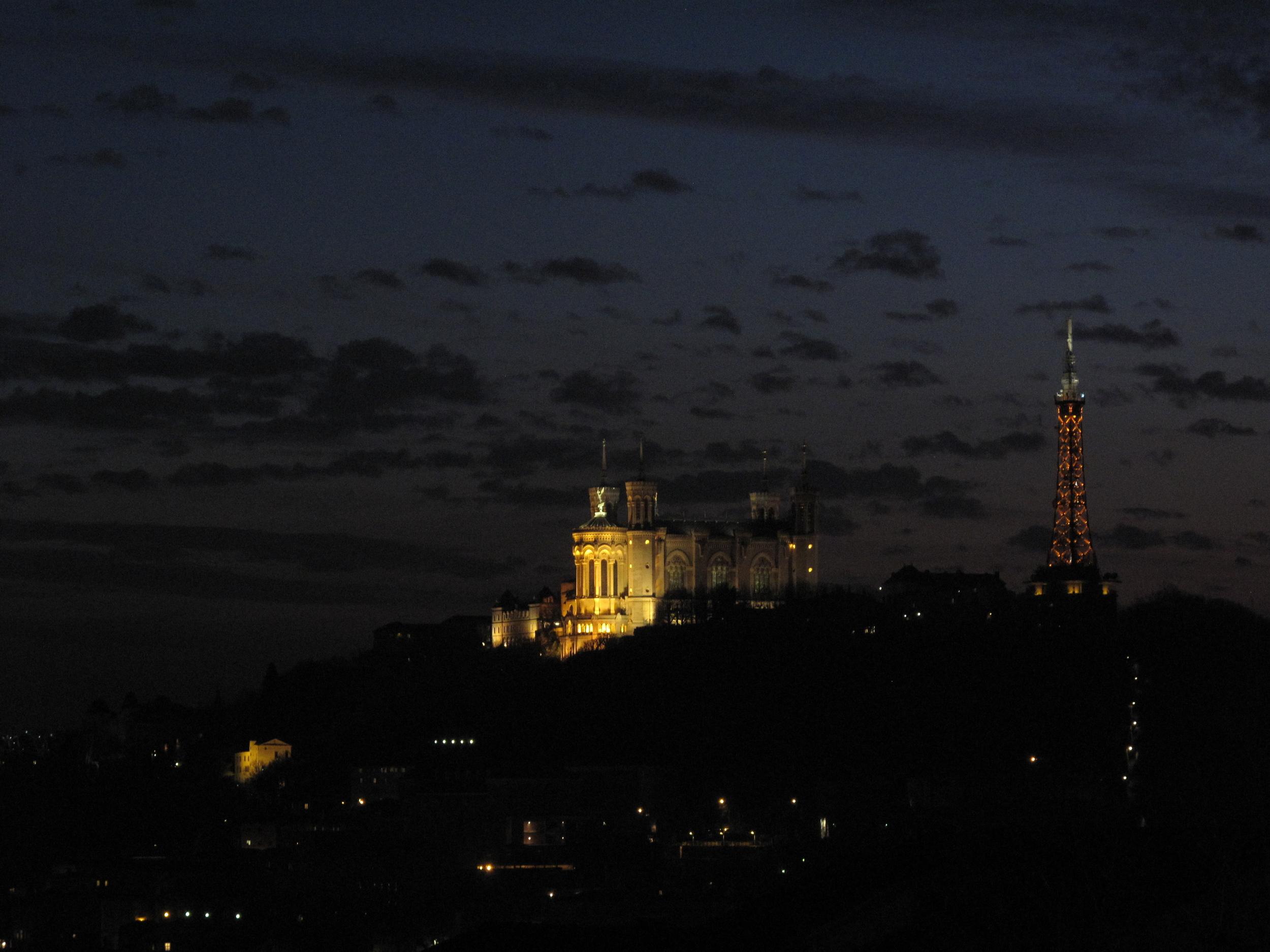Fourvière lit up at dusk in Lyon