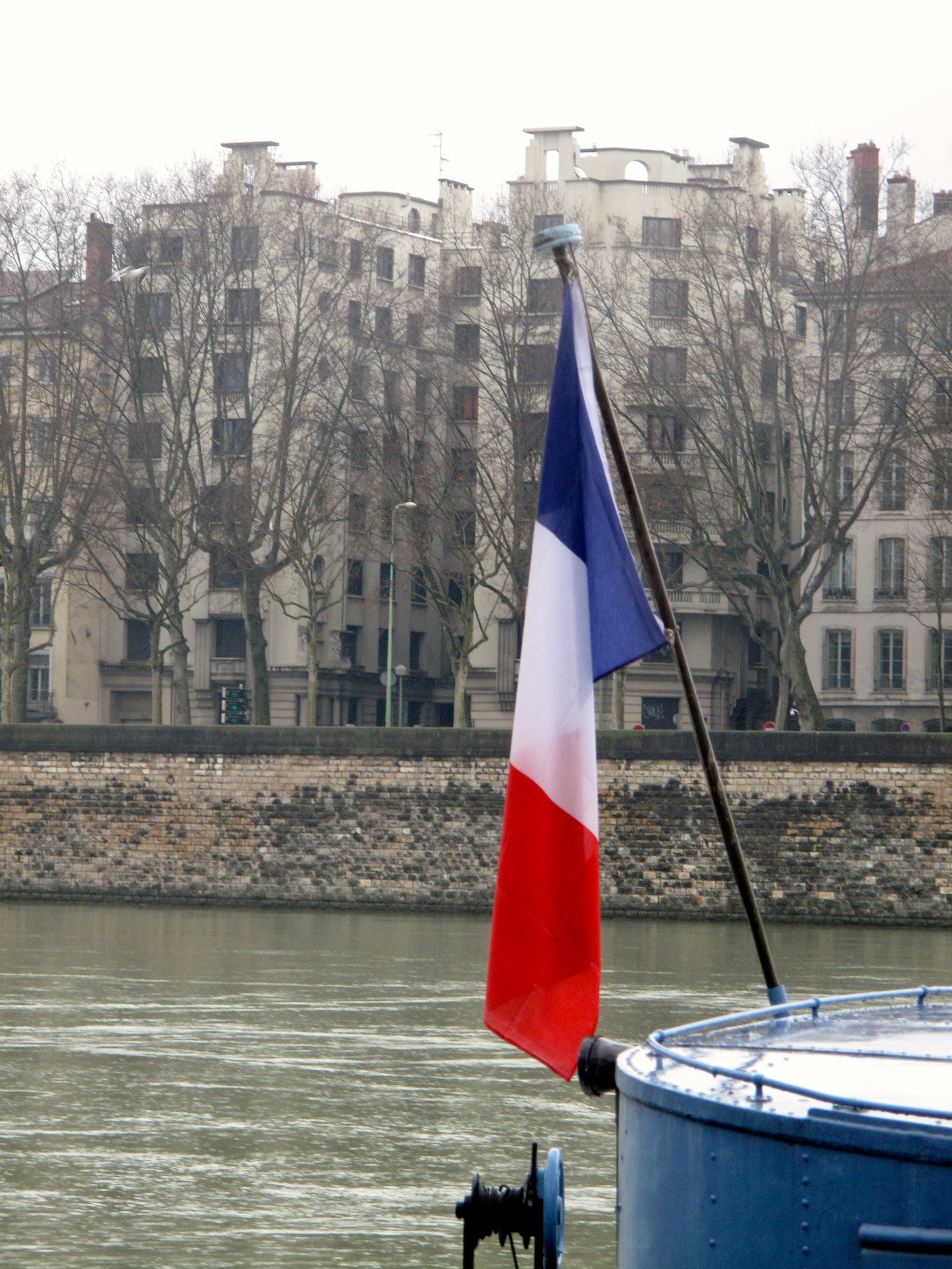 French flag on a bateaux in the Rhône river.