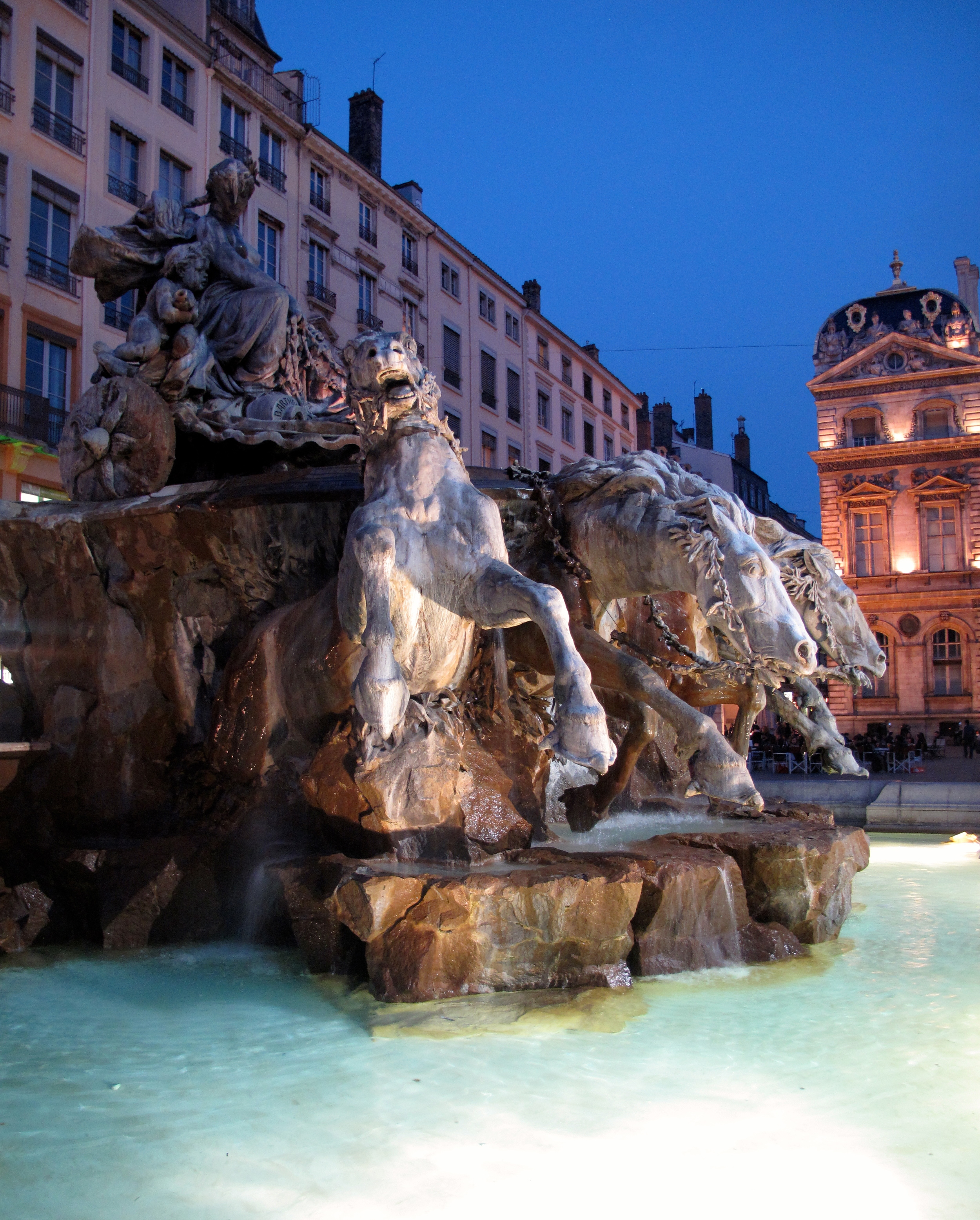 La Fontaine Bartholdi in Lyon - all lit up at night.