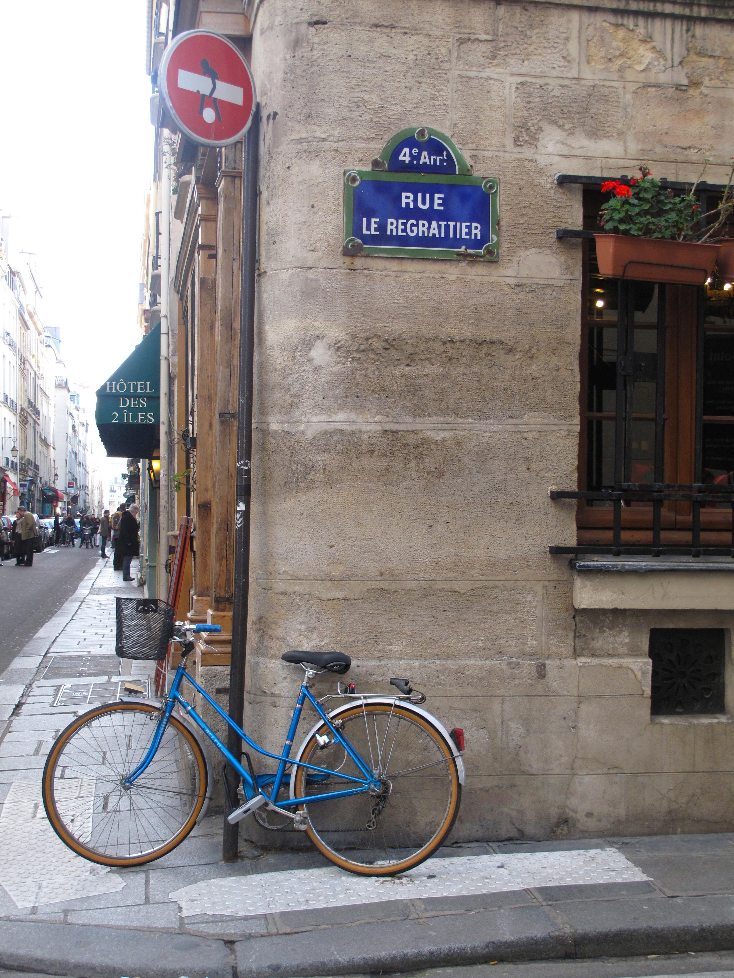 Quaint roads, signs and blue bicycles on Île Saint Louis, Paris