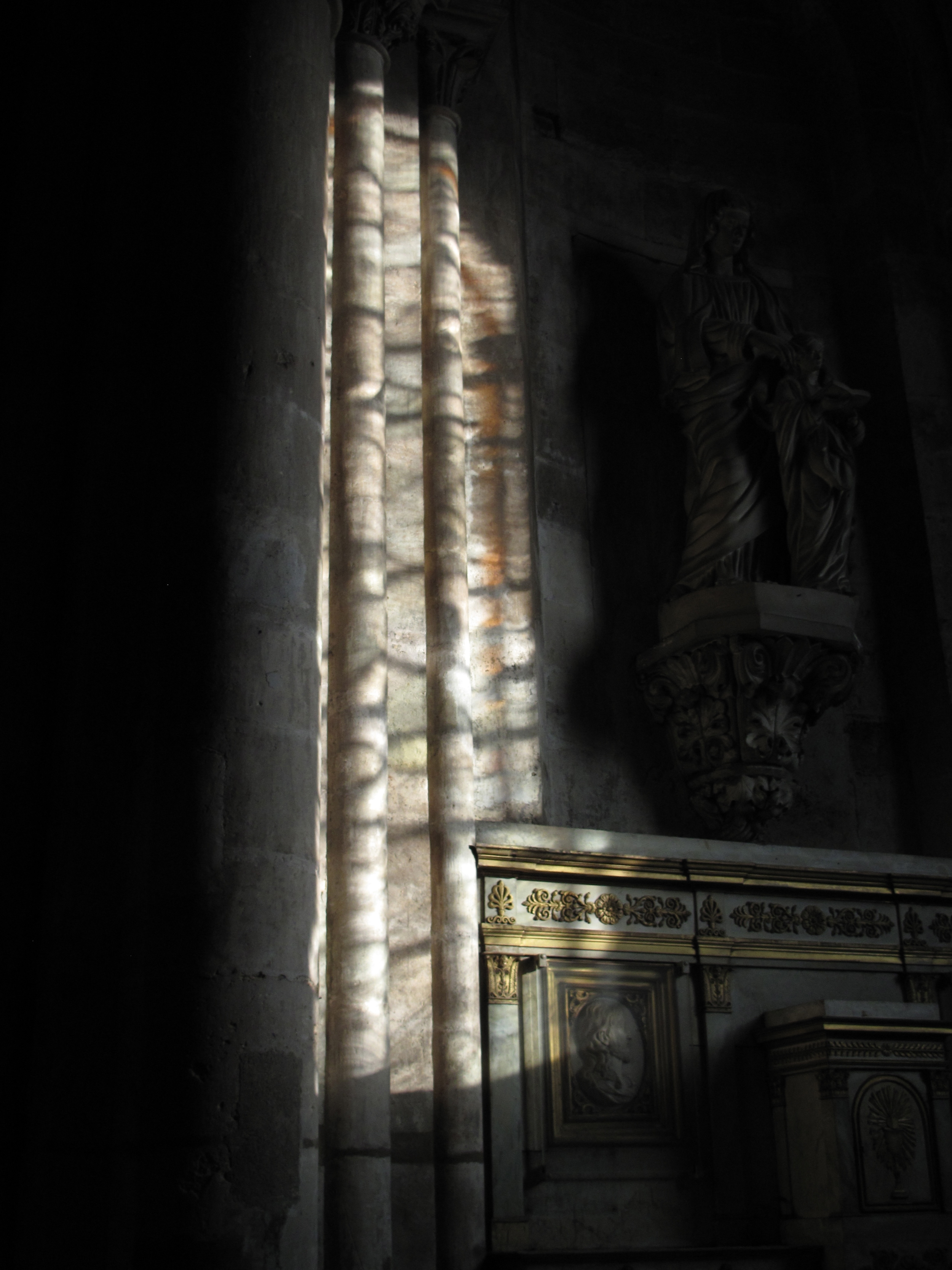 Shadows and stained glass reflections in Saint-Sulpice