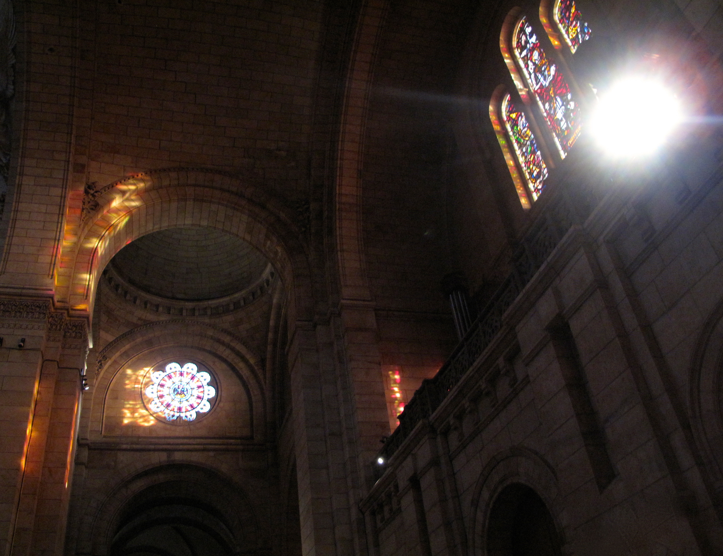 The reflections of stained glass at sunrise inside Sacré Coeur