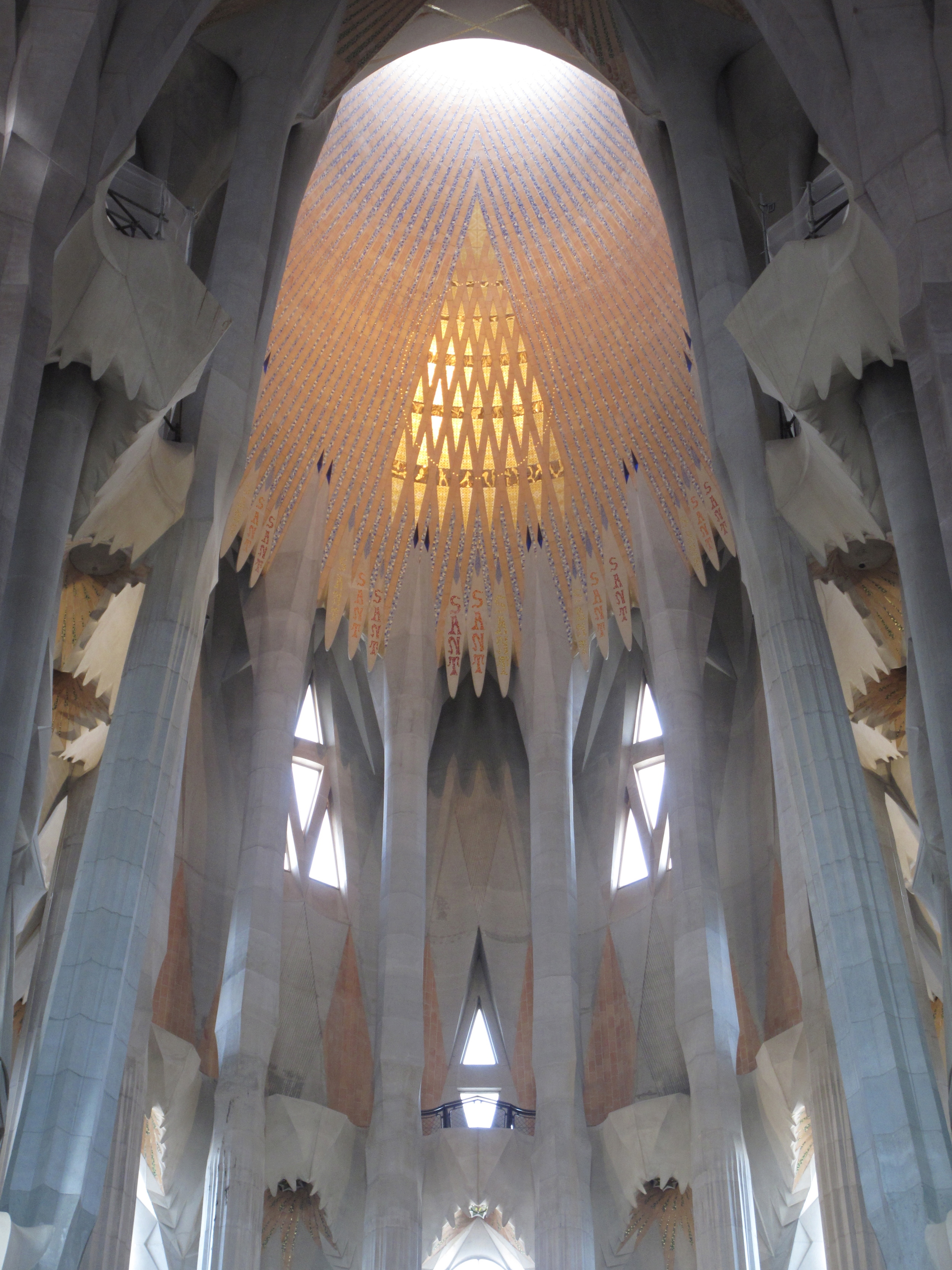 Inside of Sagrada Familia, rays of light on the ceiling