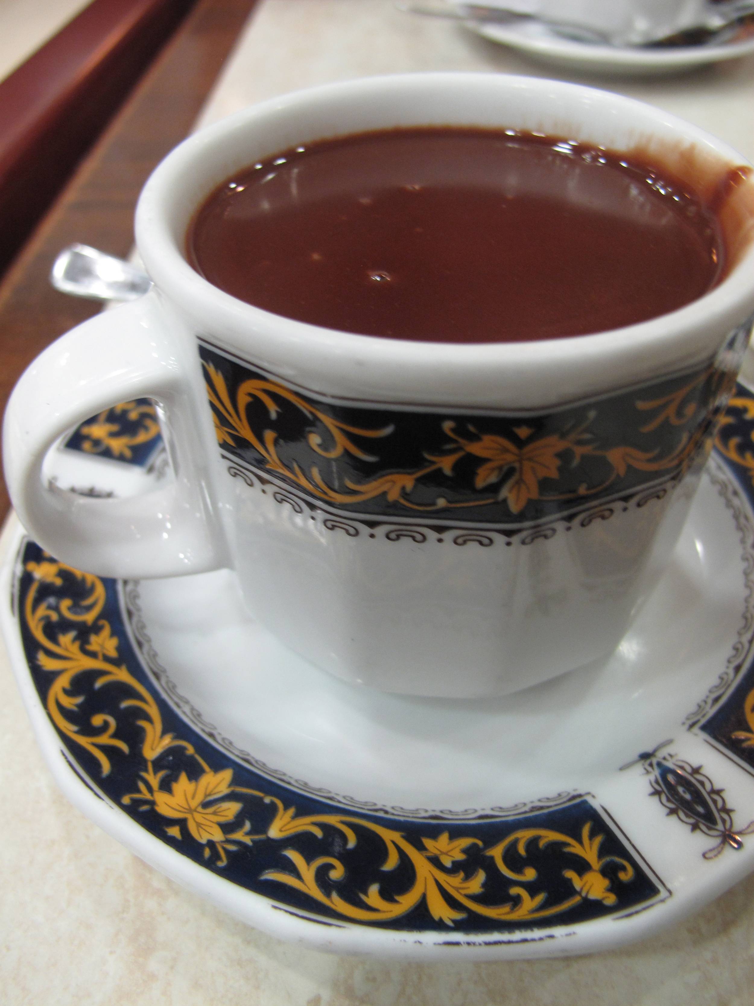 Tea cup full of chocolate for dipping churros in