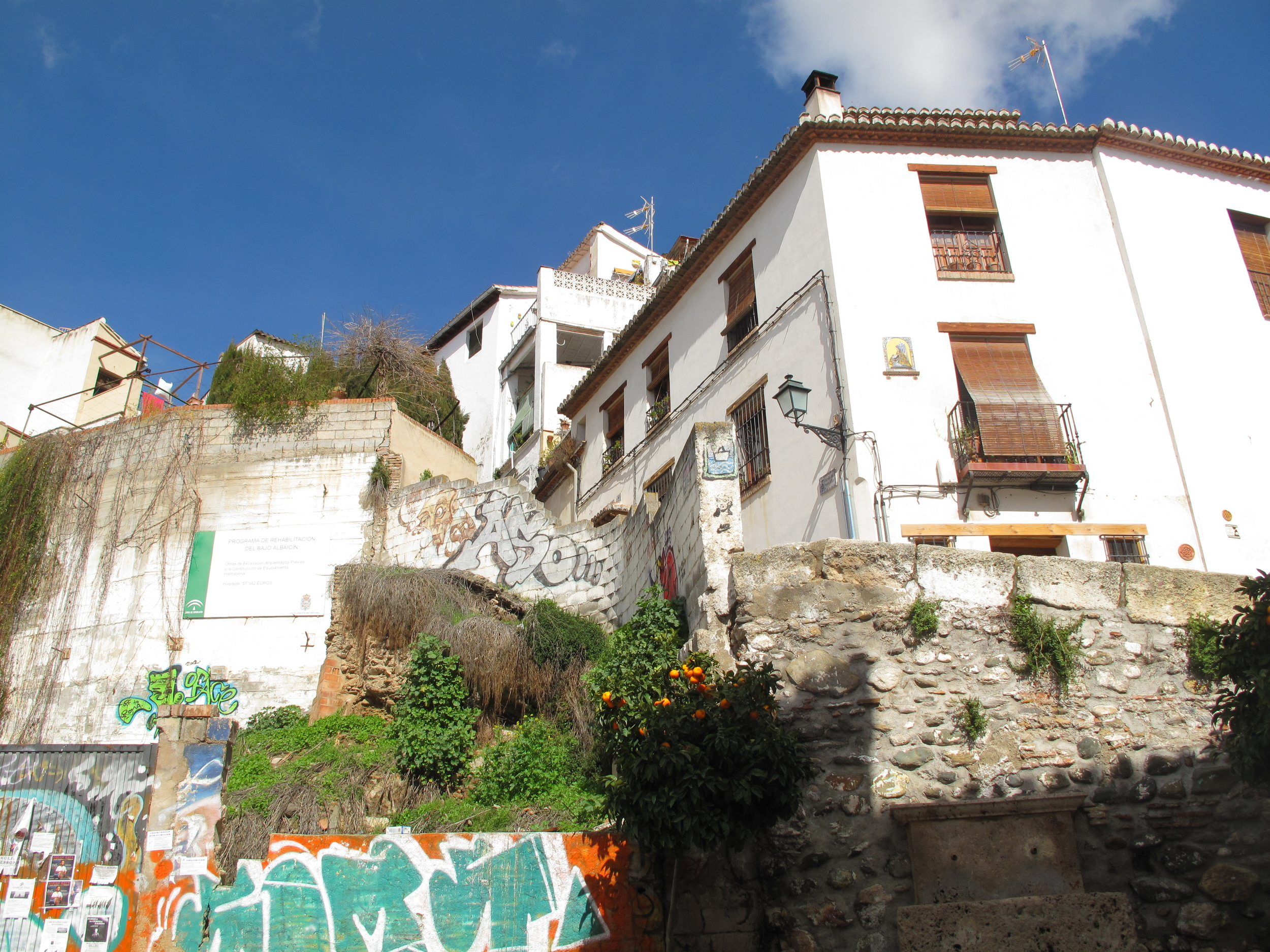 Old white houses and new graffiti in Granada
