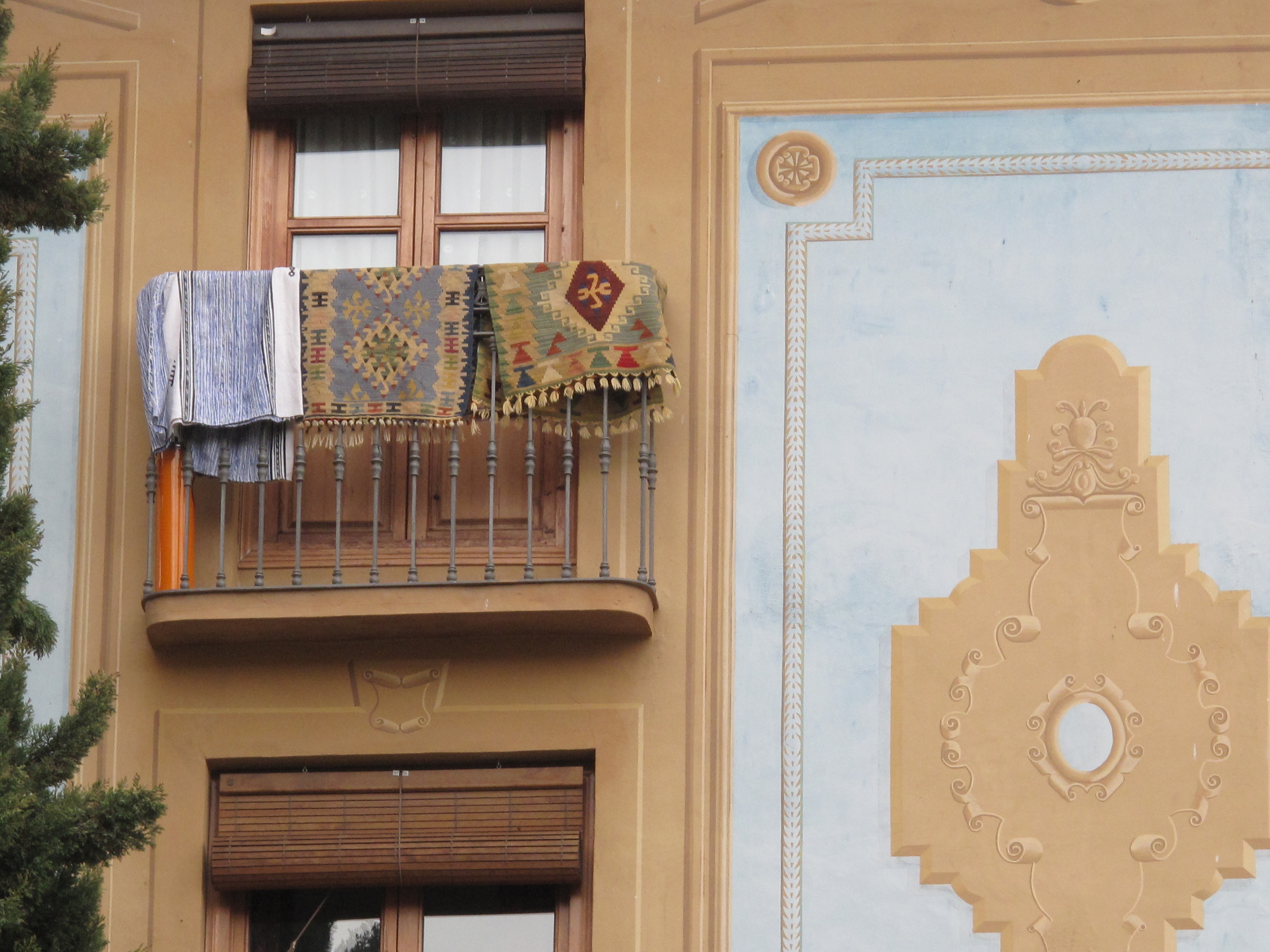 Carpets hanging on a balcony in Granada