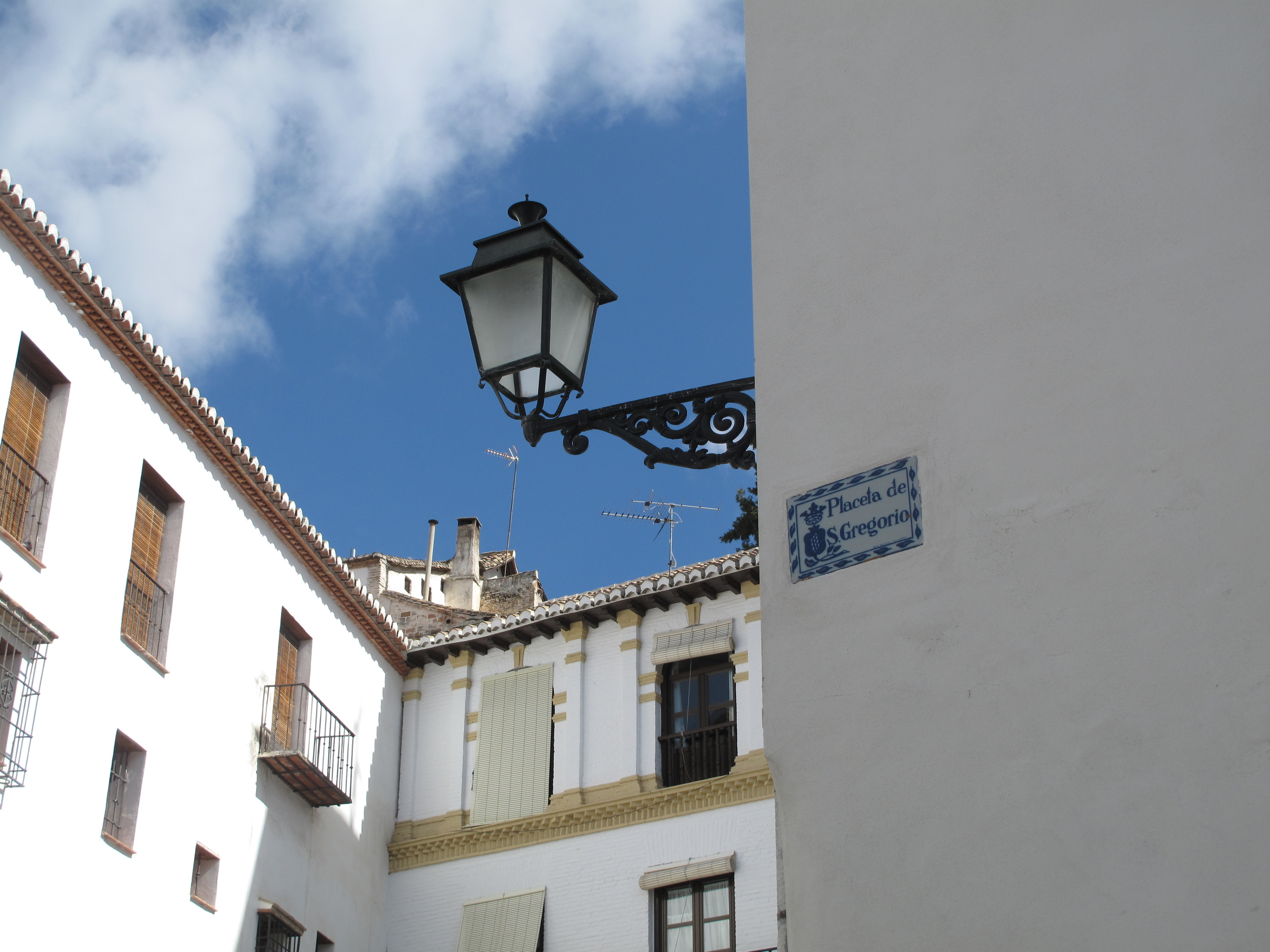 street lamps and signs in the white washed hills of Granada