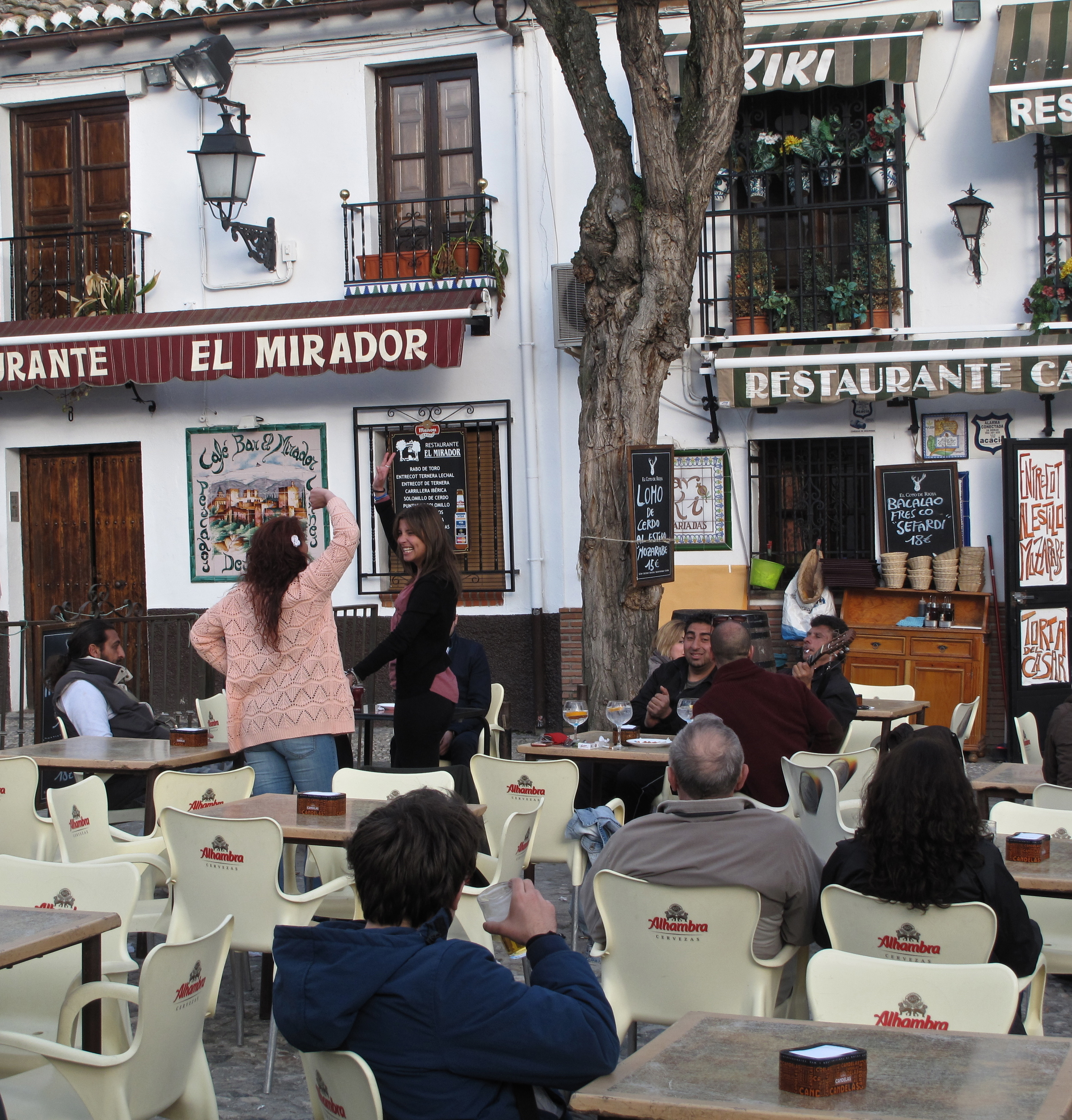 Women who started spontaneously dancing flamenco while men sing and play the guitar