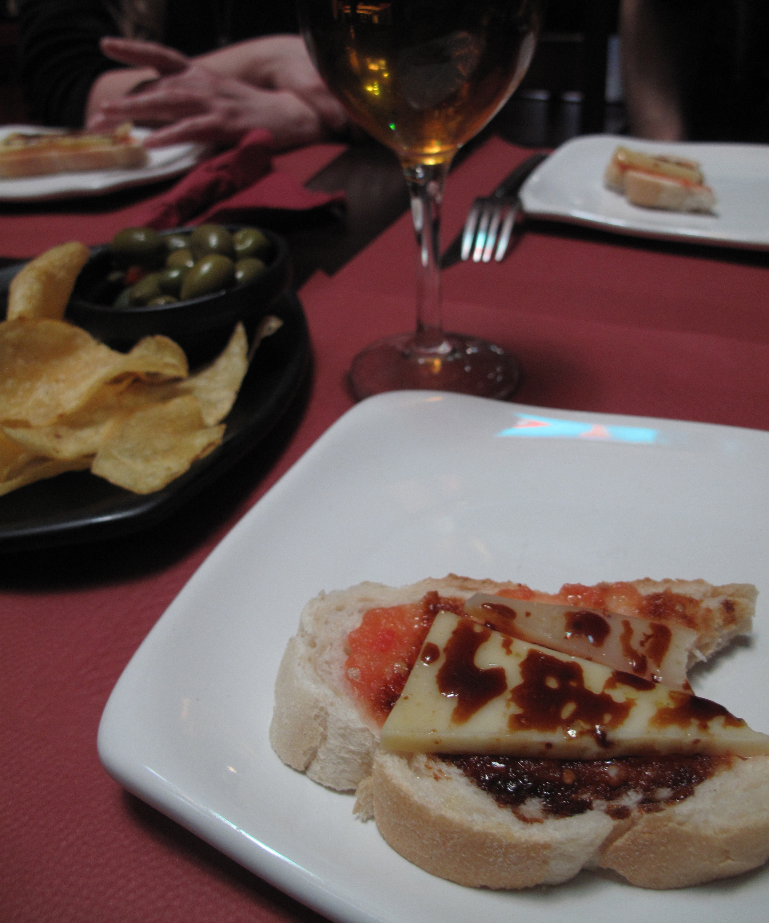 tapas of bread and cheese and olives