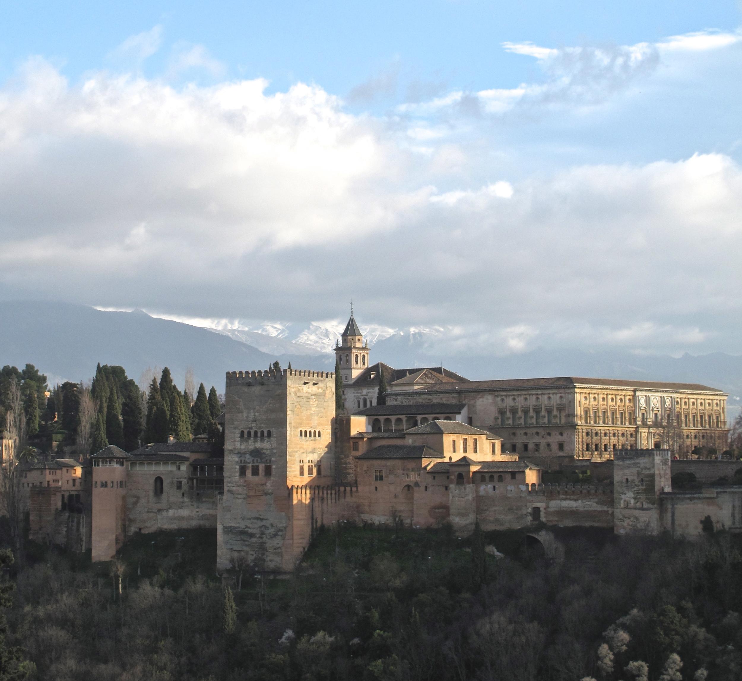 The alhambra - medieval muslim castles under a blue sky