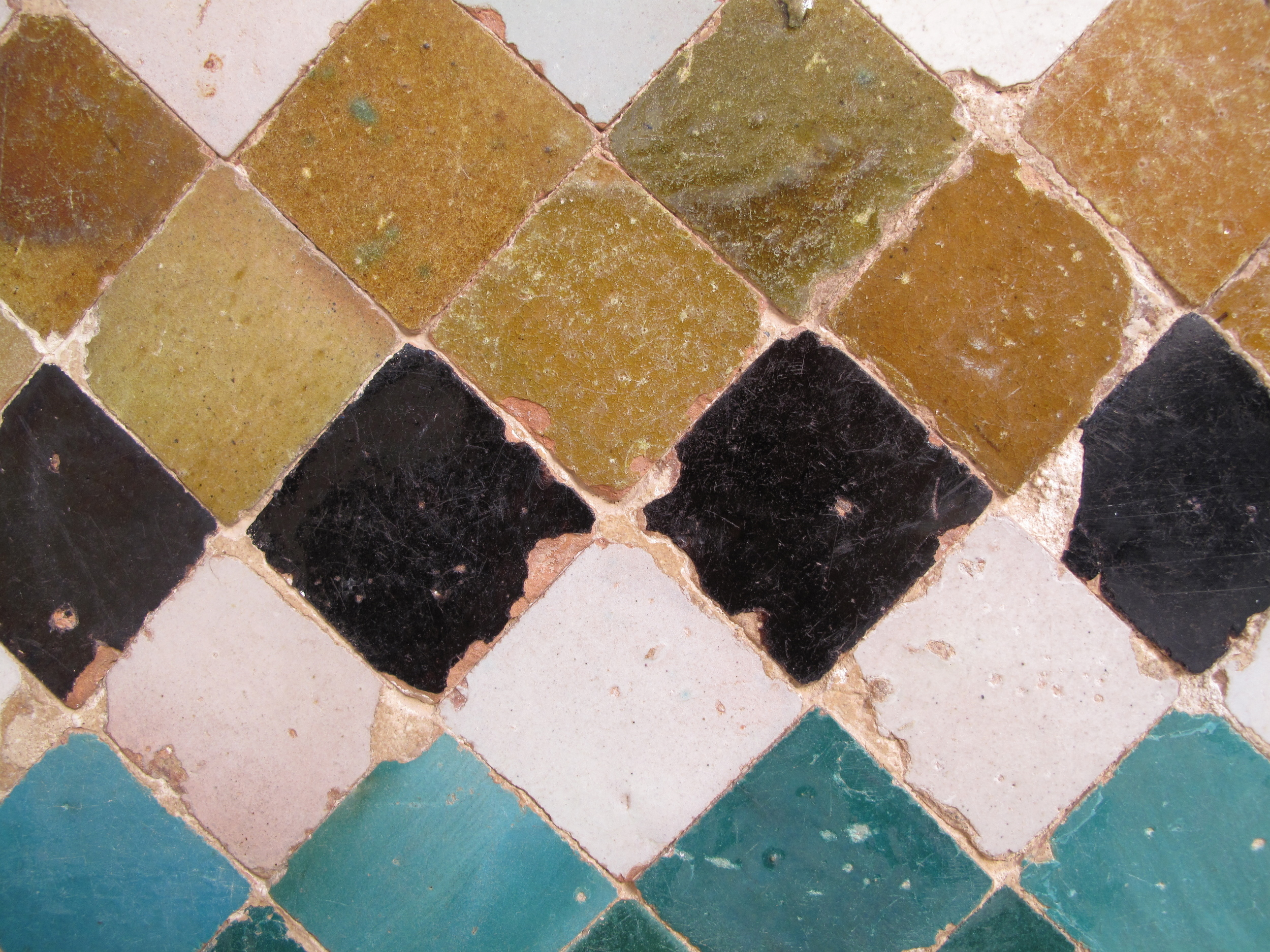 medieval coloured tile in a pattern