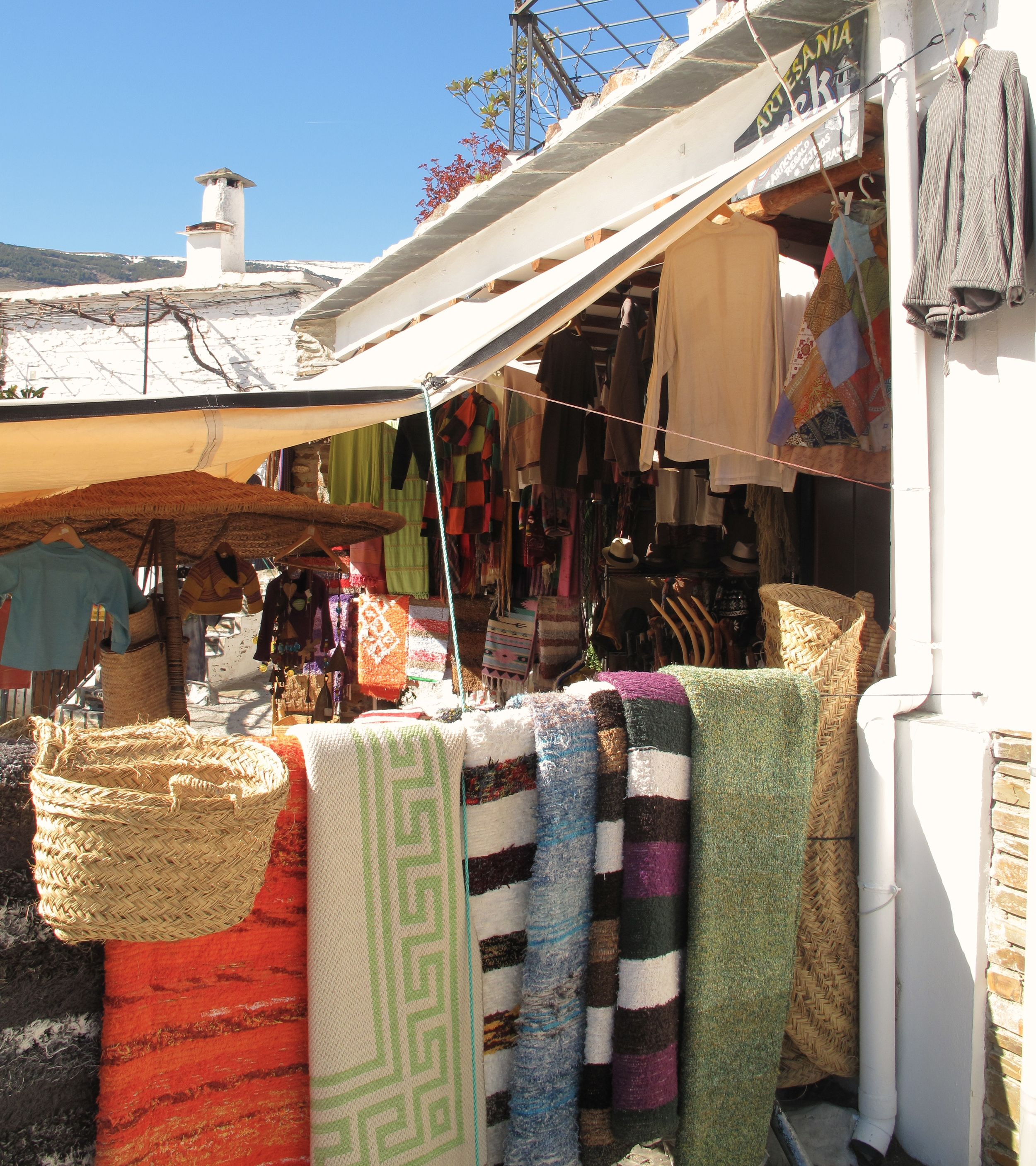 Purveyor of fine spanish mountain wares - carpets and painted chairs