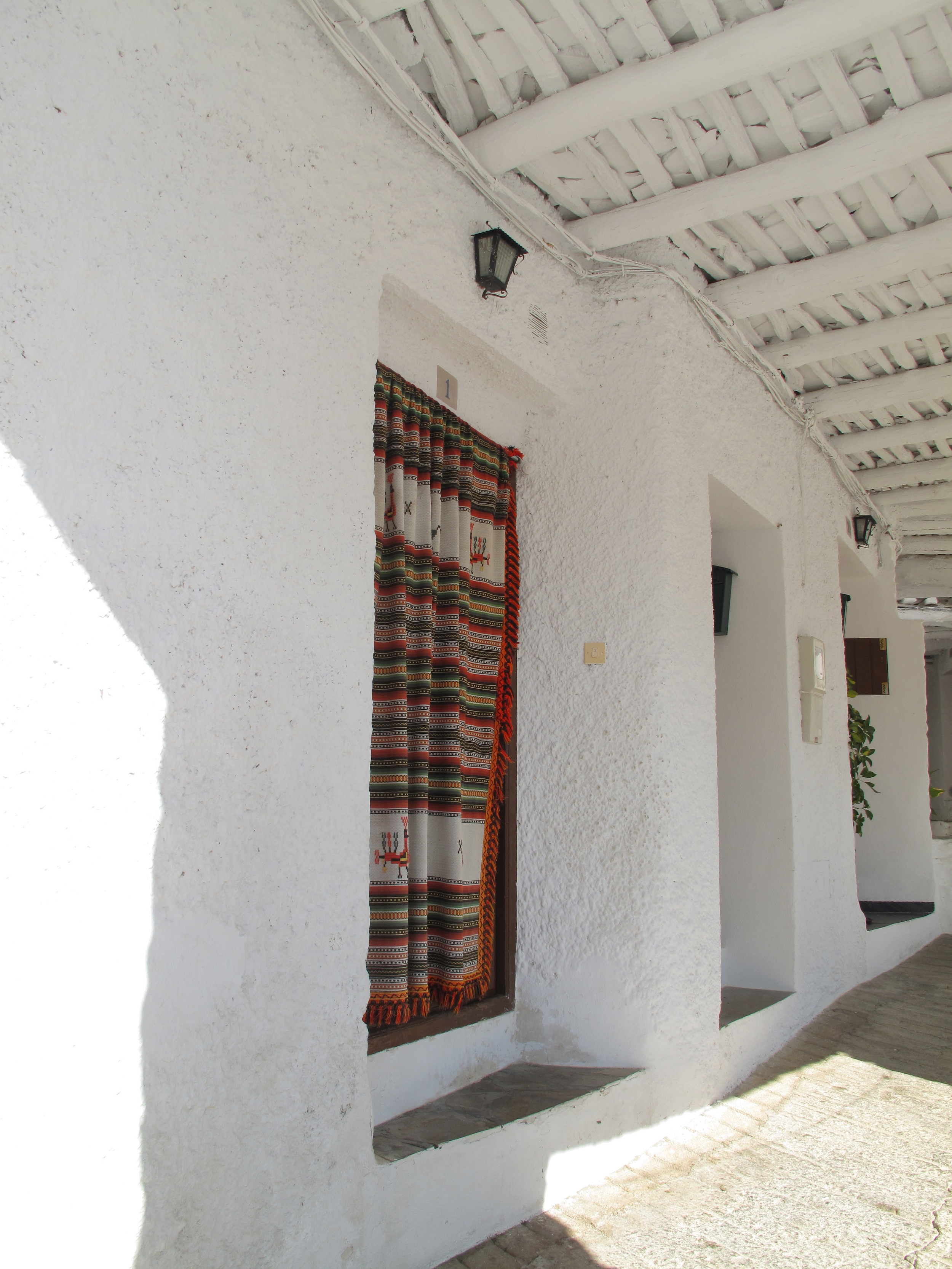 carpet door hanging and white walls and siesta time in the Spanish mountains