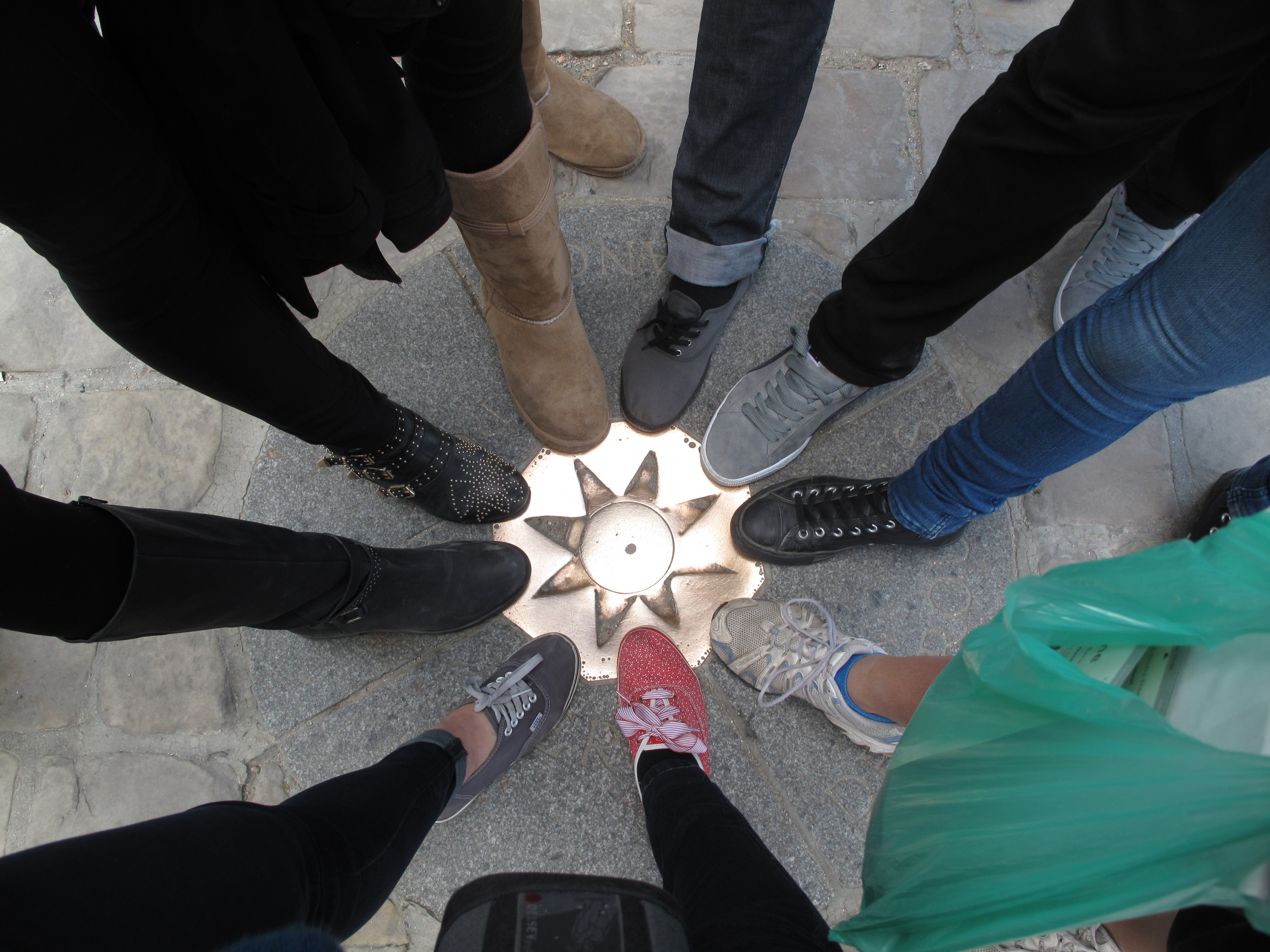 All of our feet on a golden disc in Paris